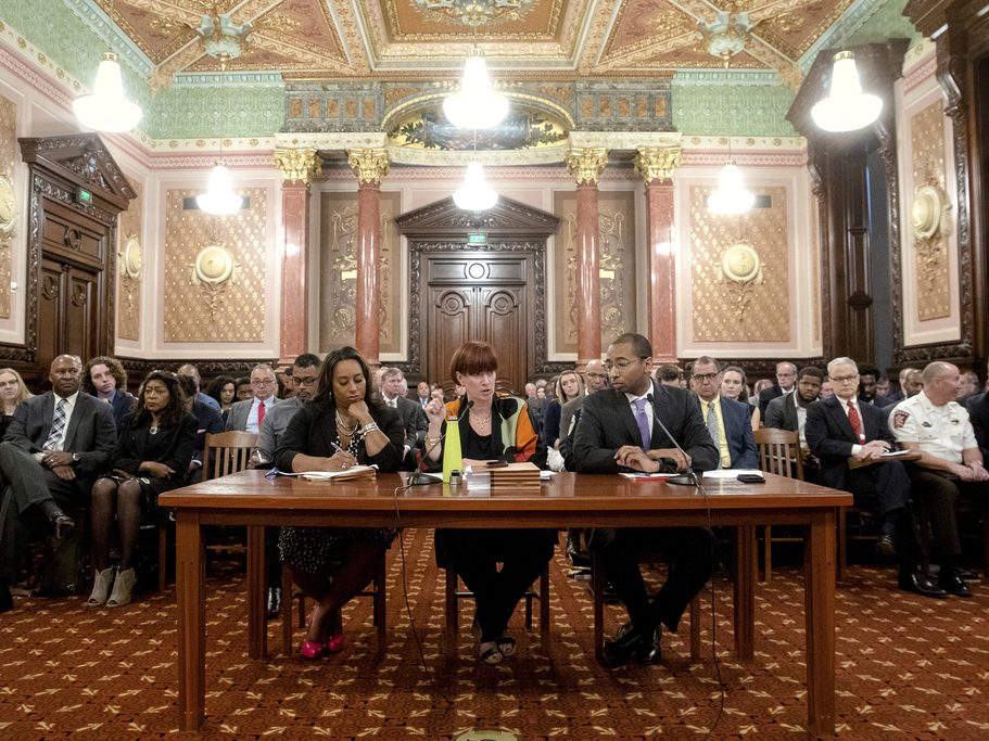State Sen. Heather Steans, D-Chicago, flanked by Sen. Toi Hutchinson, D-Olympia Fields, left, and deputy governor Christian Mitchell answers questions during a Senate Executive Committee.