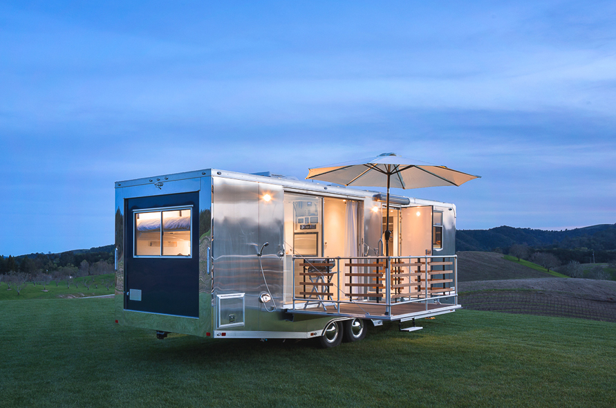 Luxury camper trailer sleeps six in 215 square feet