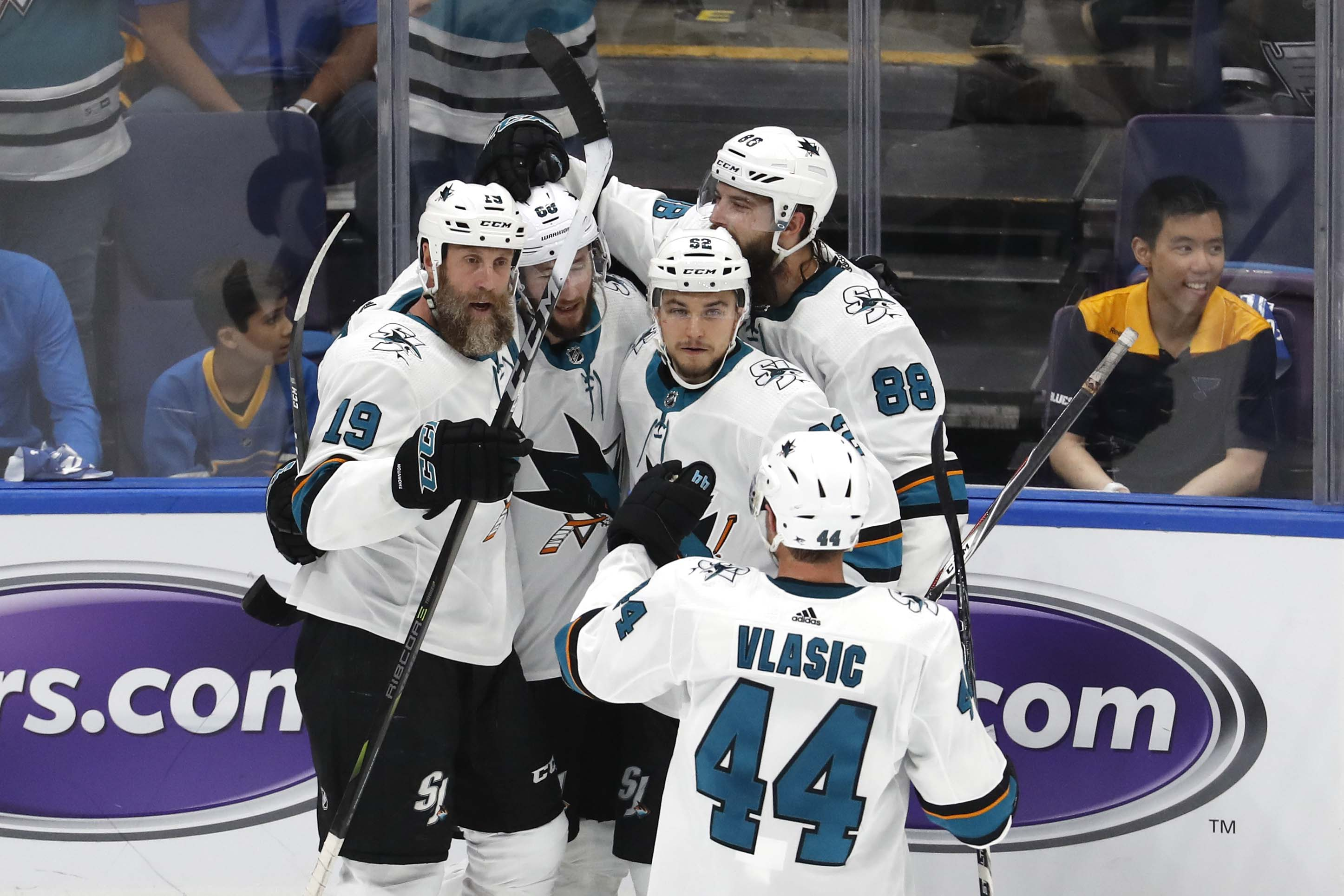 San Jose Sharks center Joe Thornton (19) is congratulated by center Melker Karlsson (68) and center Lukas Radil (52) and defenseman Brent Burns (88) and defenseman Marc-Edouard Vlasic (44) after scoring a goal against the St. Louis Blues during the first