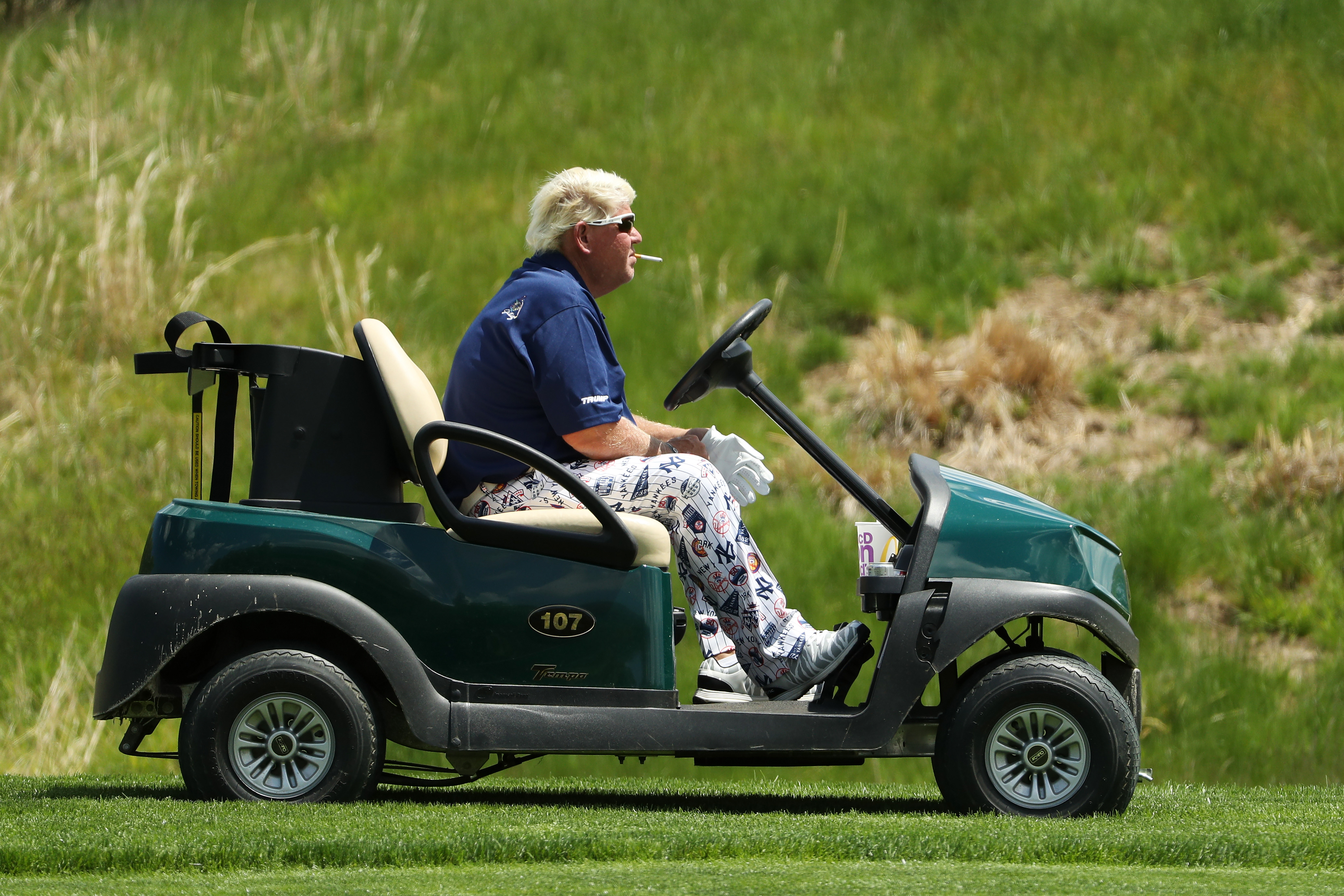 John Daly has his golf cart and cigarettes, but still looks miserable at the PGA