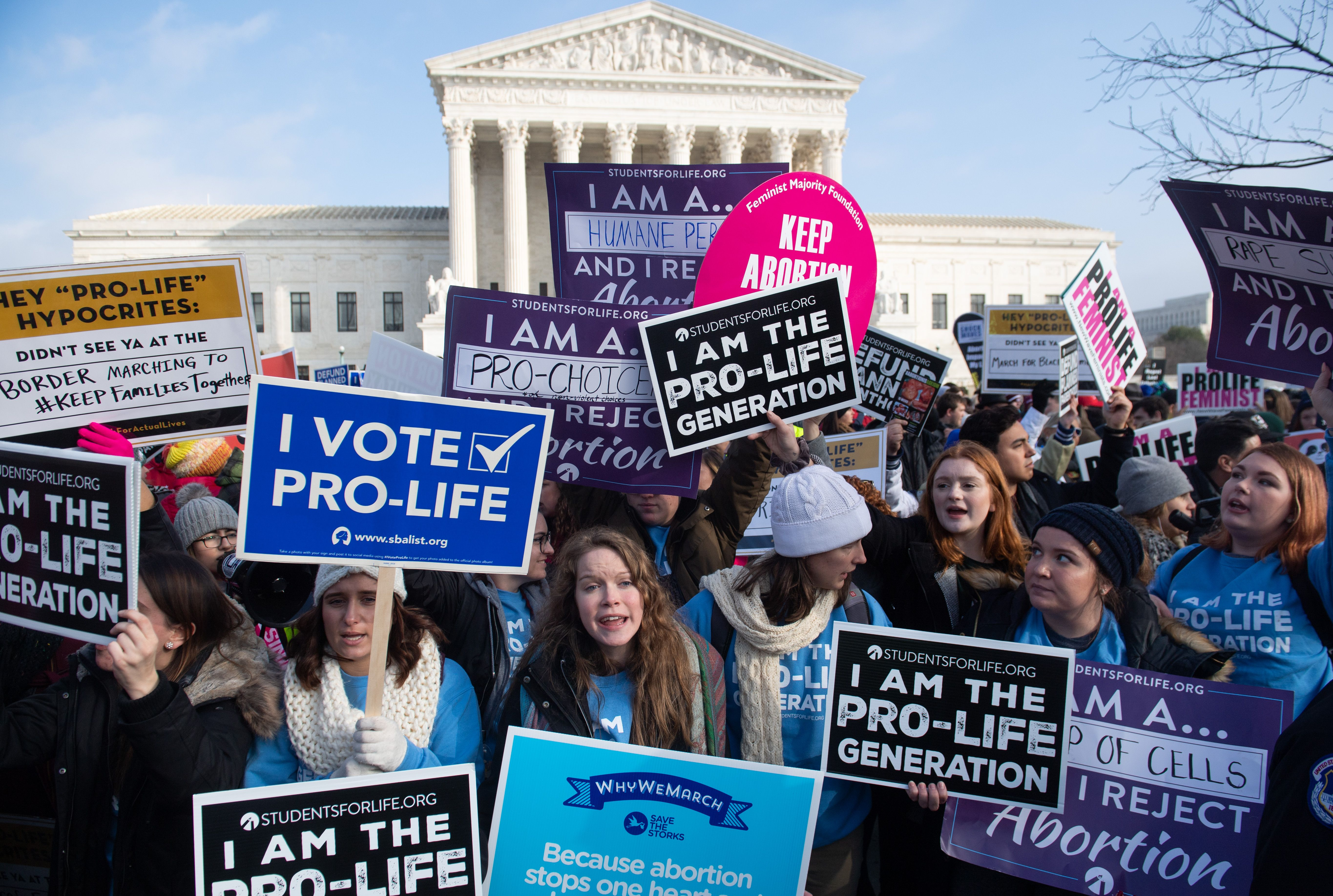 Activists on both sides of the abortion issue protest outside outside the US Supreme Court in Washington, DC, on January 18, 2019