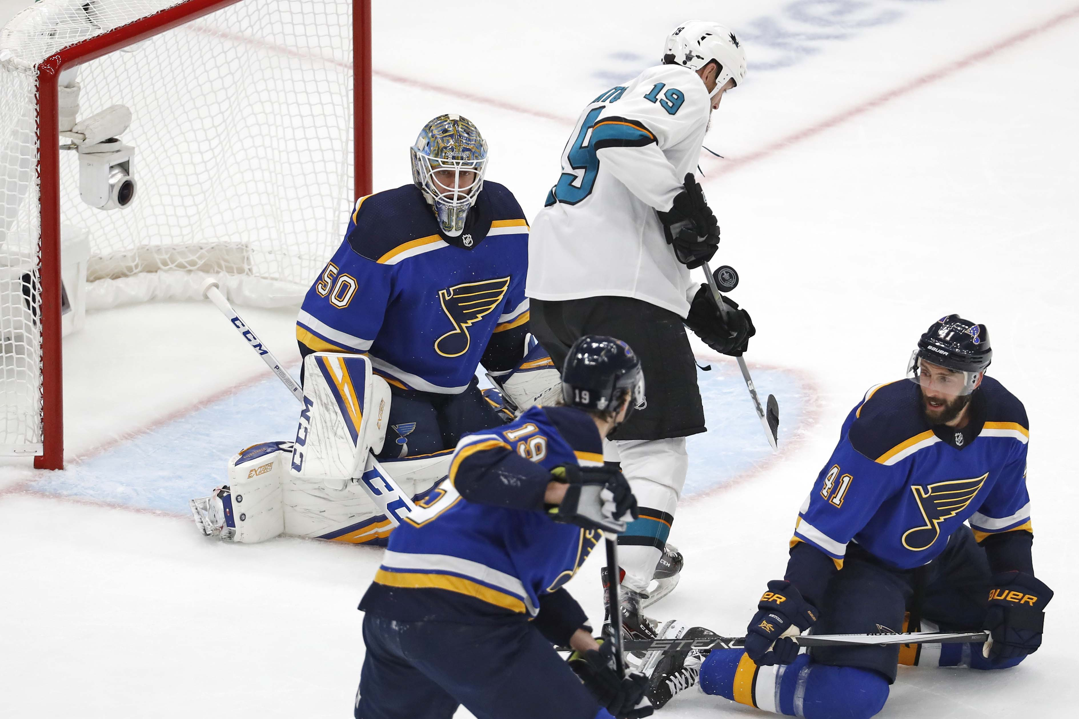 San Jose Sharks center Joe Thornton deflects a shot in front of St. Louis Blues goaltender Jordan Binnington as defenseman Jay Bouwmeester and defenseman Robert Bortuzzo look on during the first periodin game 3 of the Western Conference Final of the