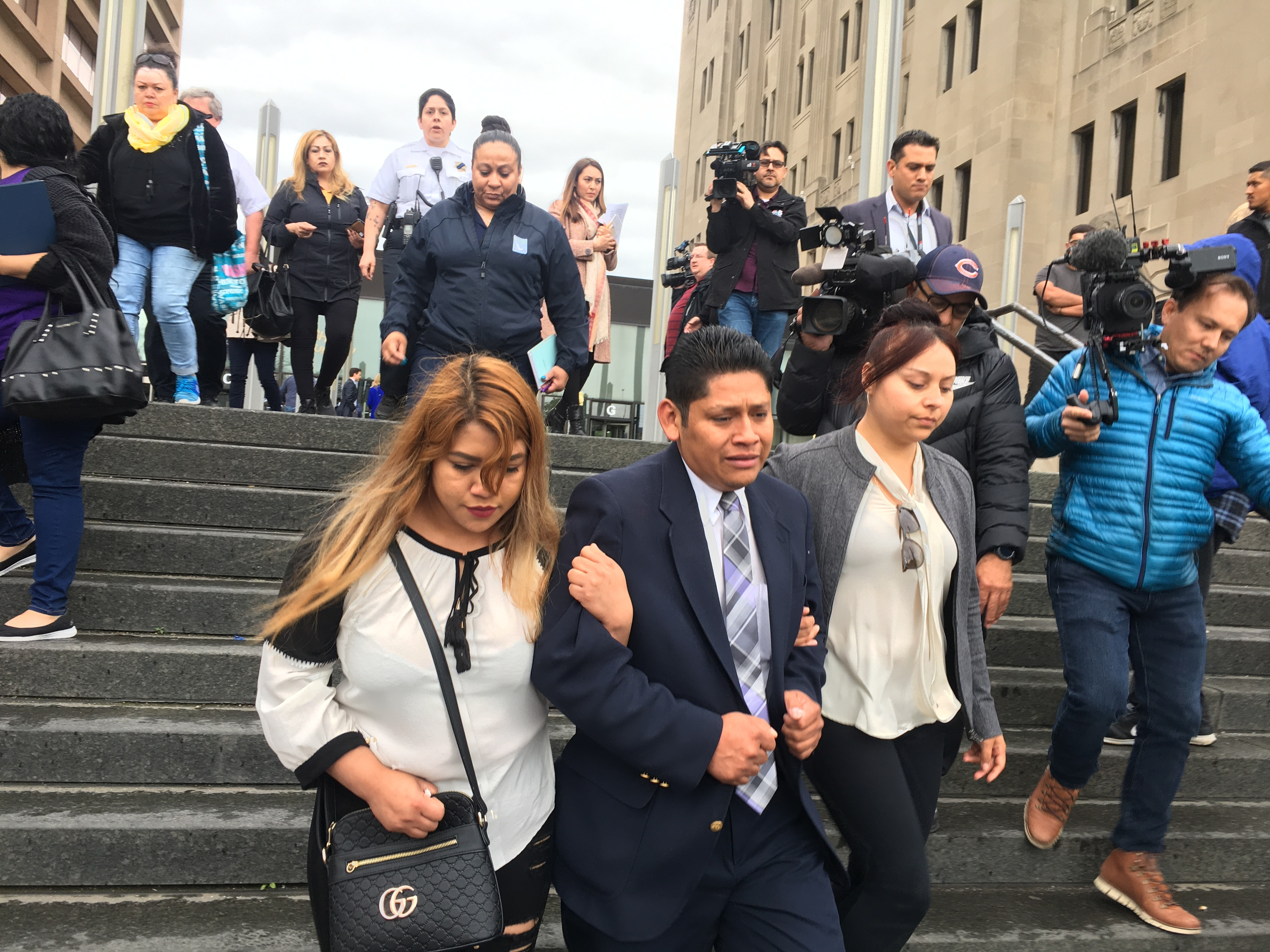 Arnulfo Ochoa (center), the father of Marlen Ochoa-Lopez, leaves the Leighton Criminal Court Building on Friday after a judge denied bail to three people in connection with Ochoa-Lopez's death.