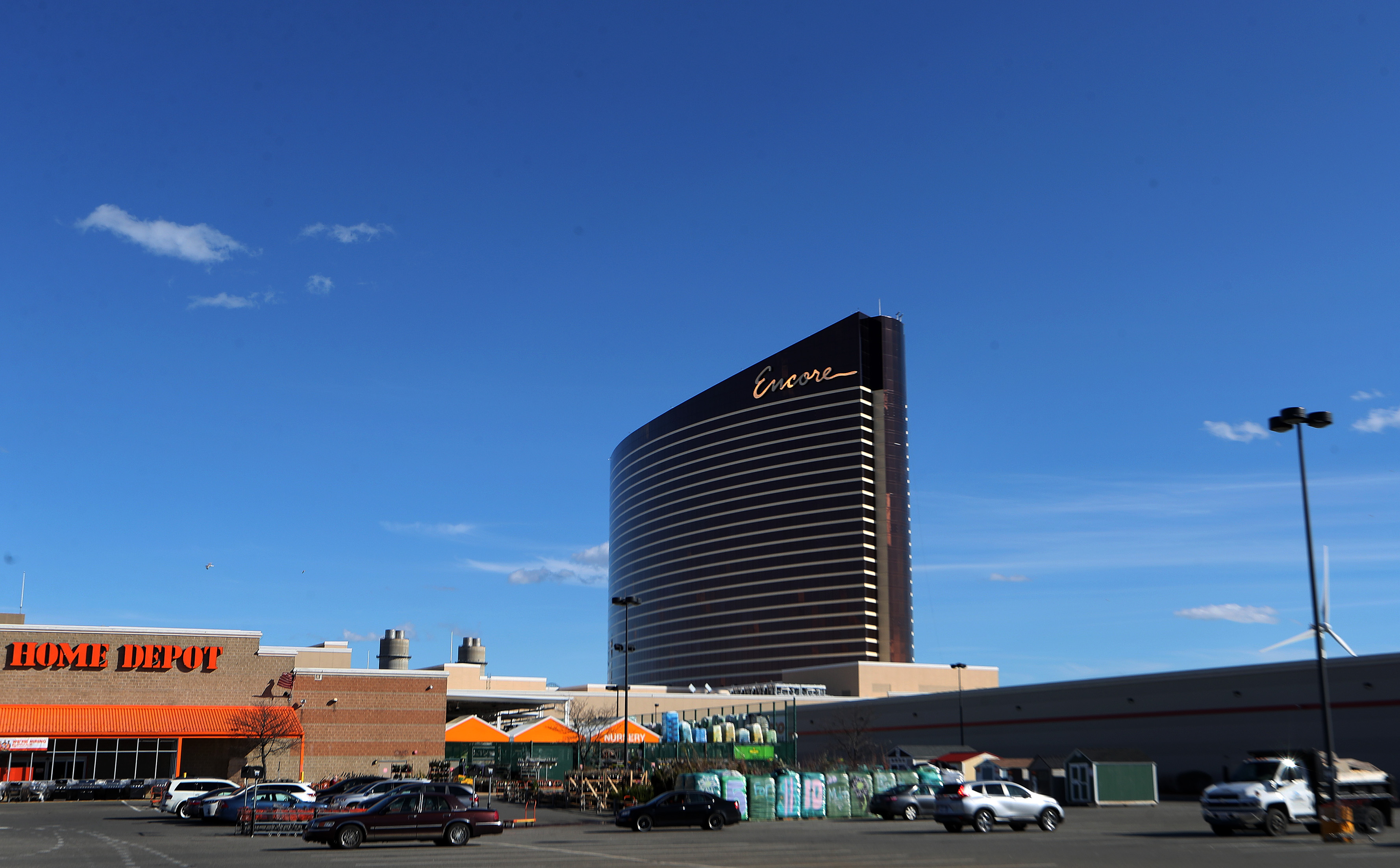 A large, rectangular, and curved building looming over a parking lot.