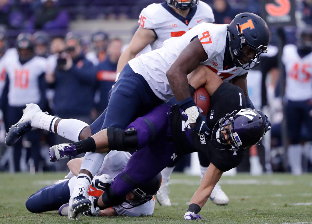 Illinois lineman Bobby Roundtree tackles a Northwestern ball carrier.