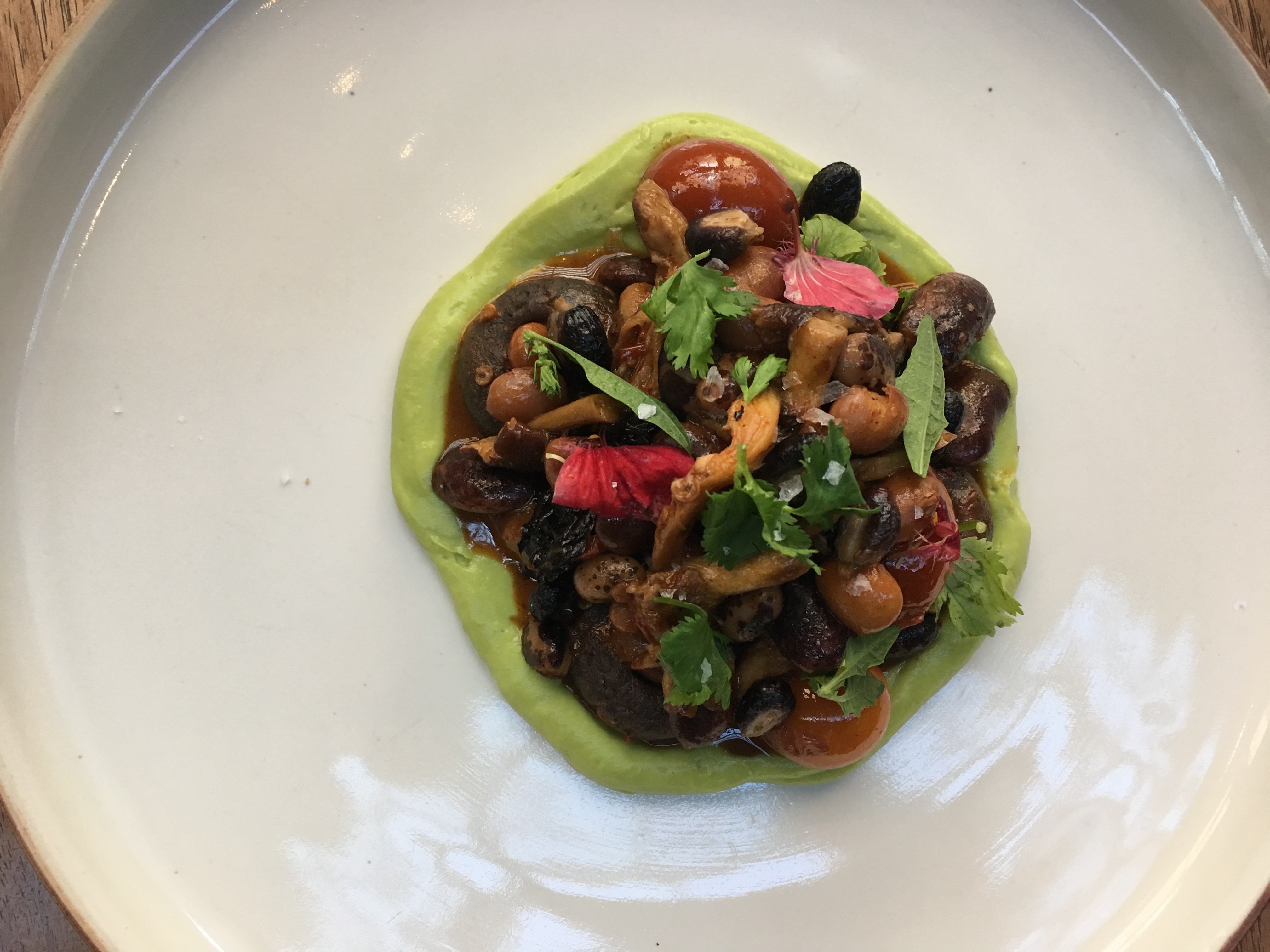 The beans, masa chochoyotes, and mushroom dish from Comedor