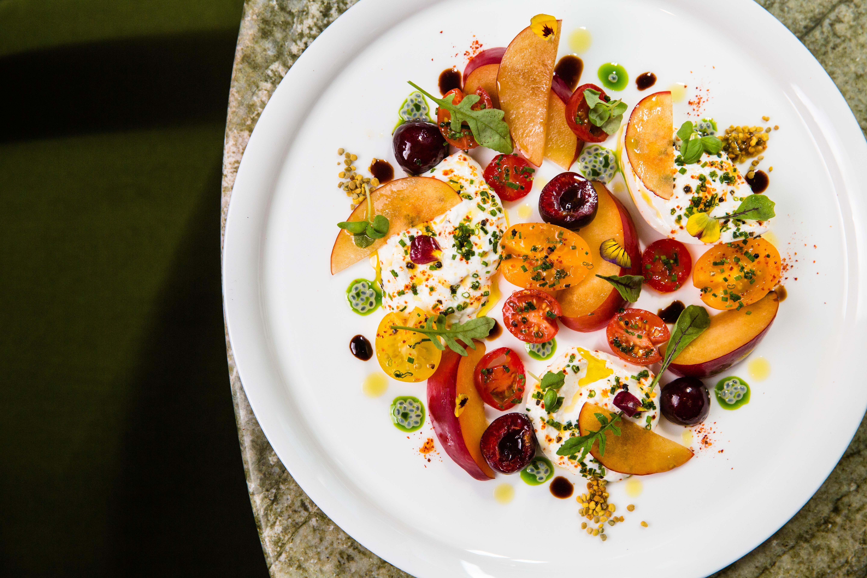 Heirloom tomatoes, stone fruits, and burrata at Le Jardinier