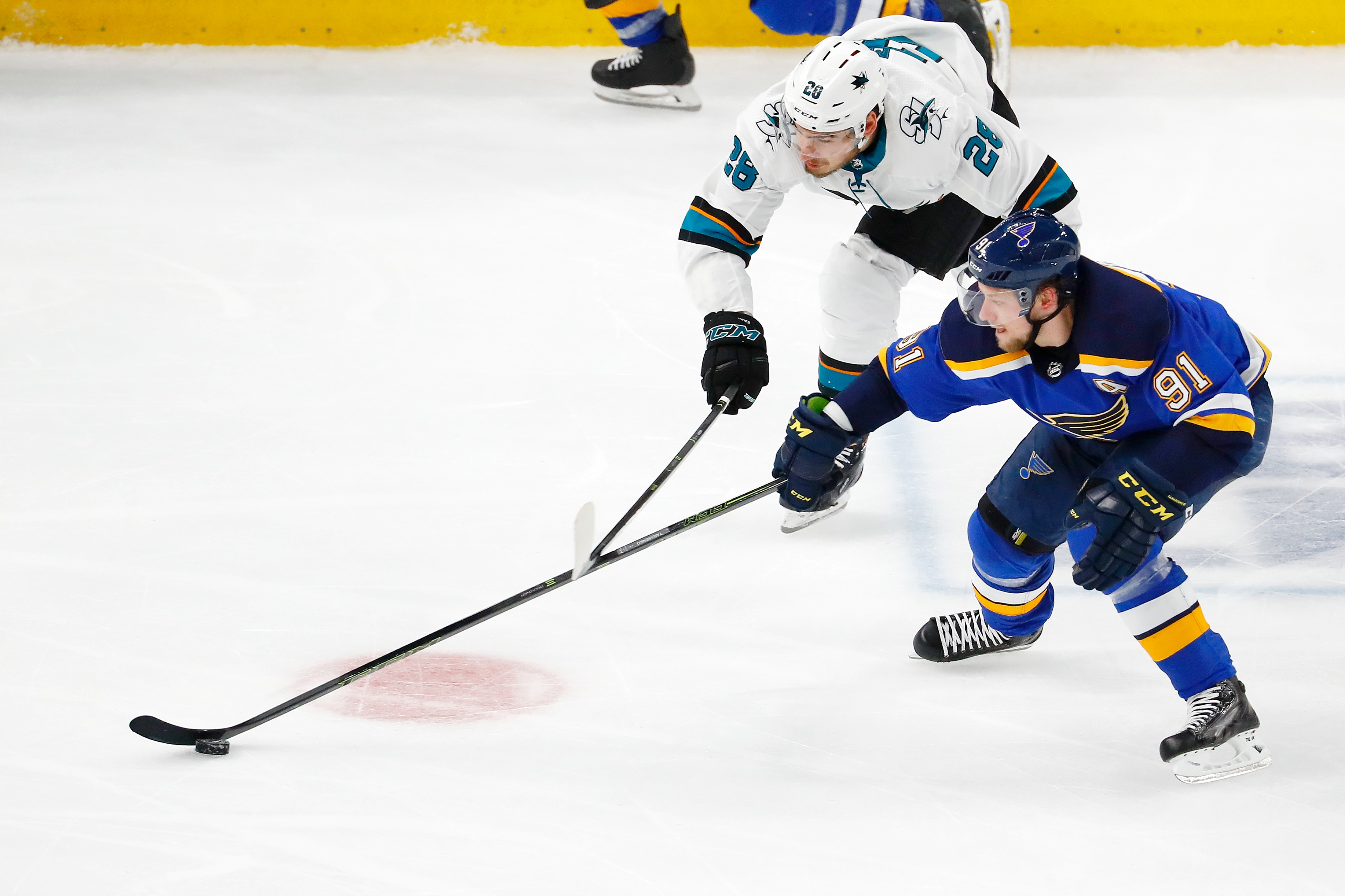 May 21, 2019; St. Louis, MO, USA; St. Louis Blues right wing Vladimir Tarasenko (91) and San Jose Sharks right wing Timo Meier (28) battle for a loose puck during the second period in game six of the Western Conference Final of the 2019 Stanley Cup Playof