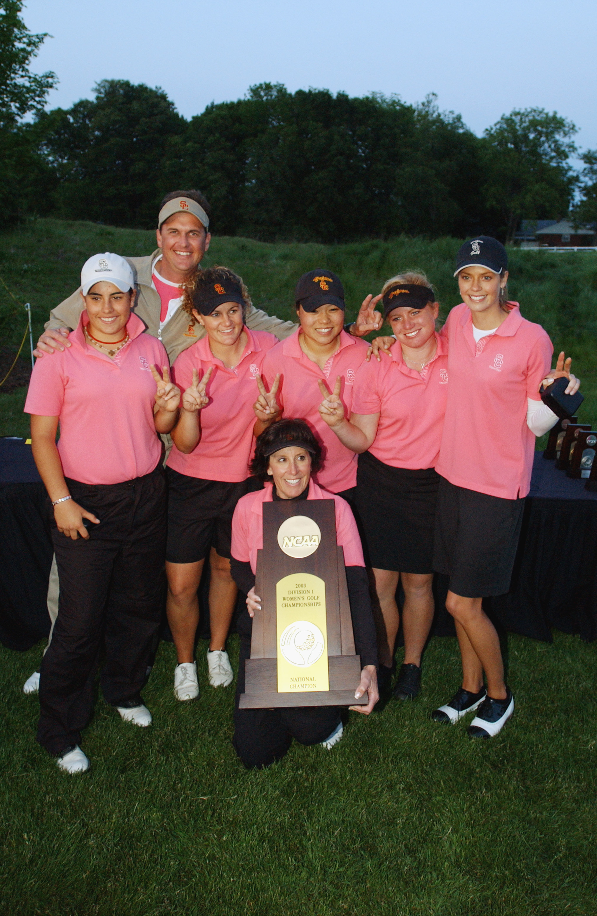USC poses for photographers with trophy