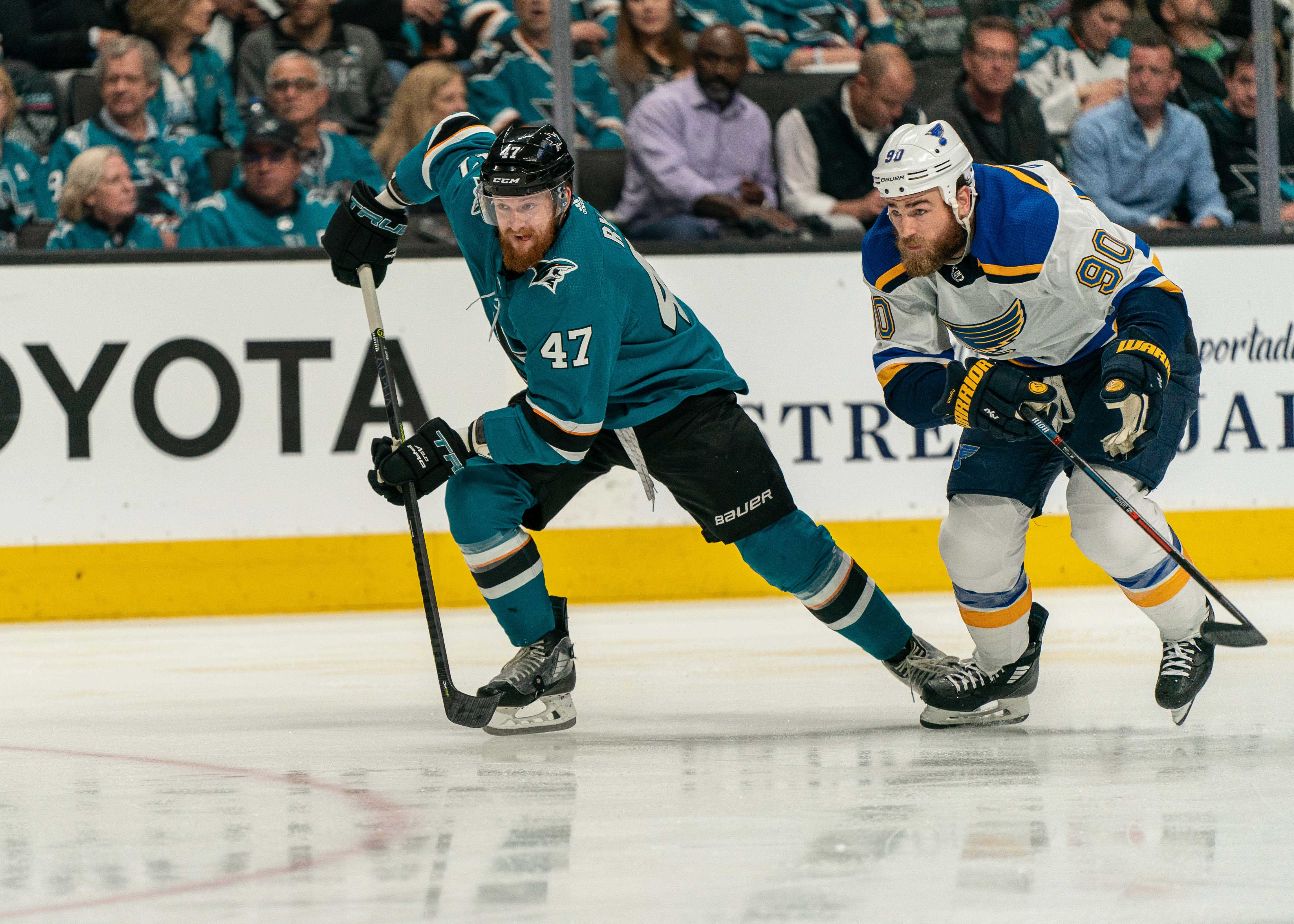 San Jose Sharks defenseman Joakim Ryan (47) and St. Louis Blues center Ryan O'Reilly (90) race for the puck during the second period in game two of the Western Conference Final of the 2019 Stanley Cup Playoffs at SAP Center at San Jose.