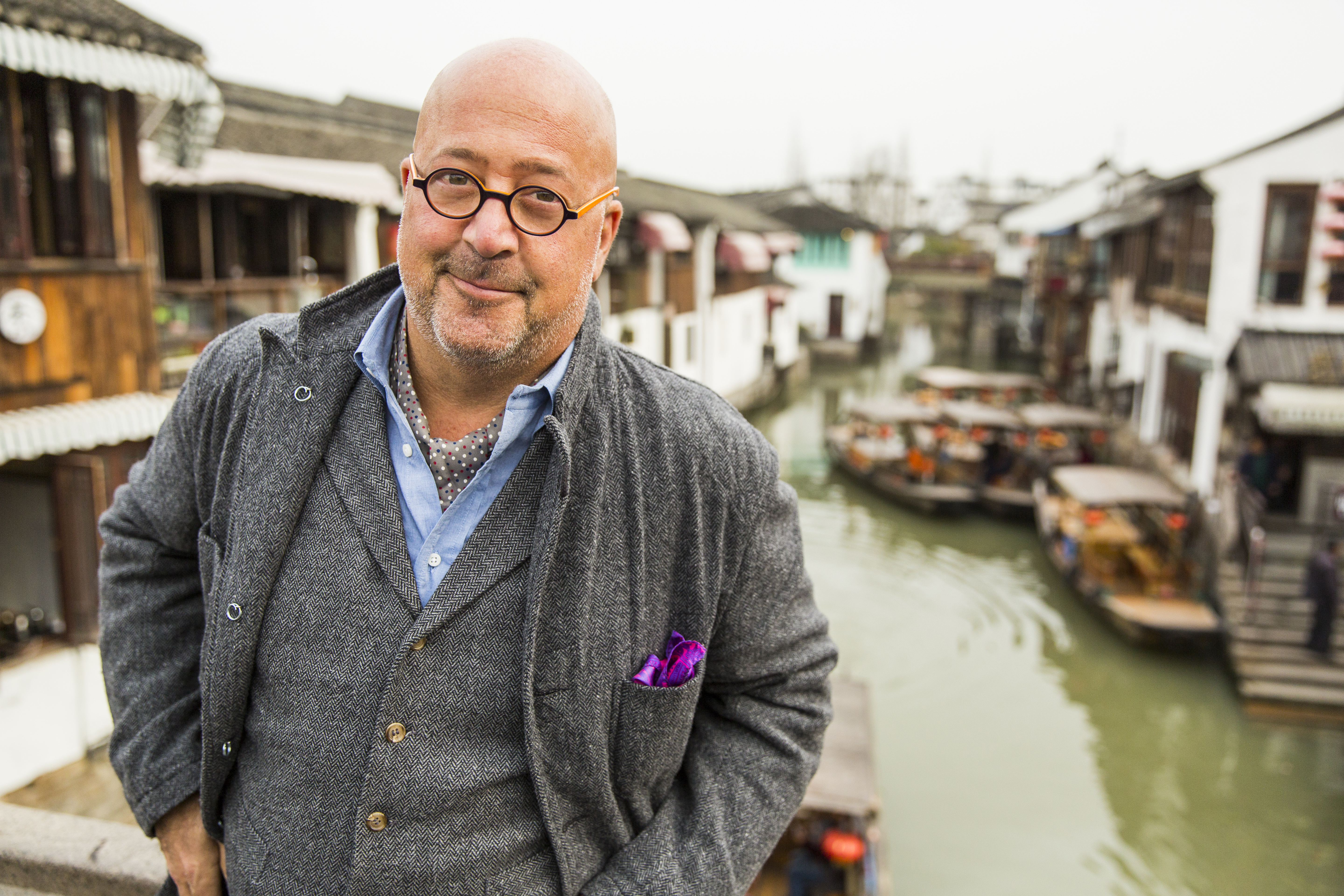 Bizarre Foods host Andrew Zimmern on a bridge in the ancient water town of Zhujiajiao in China