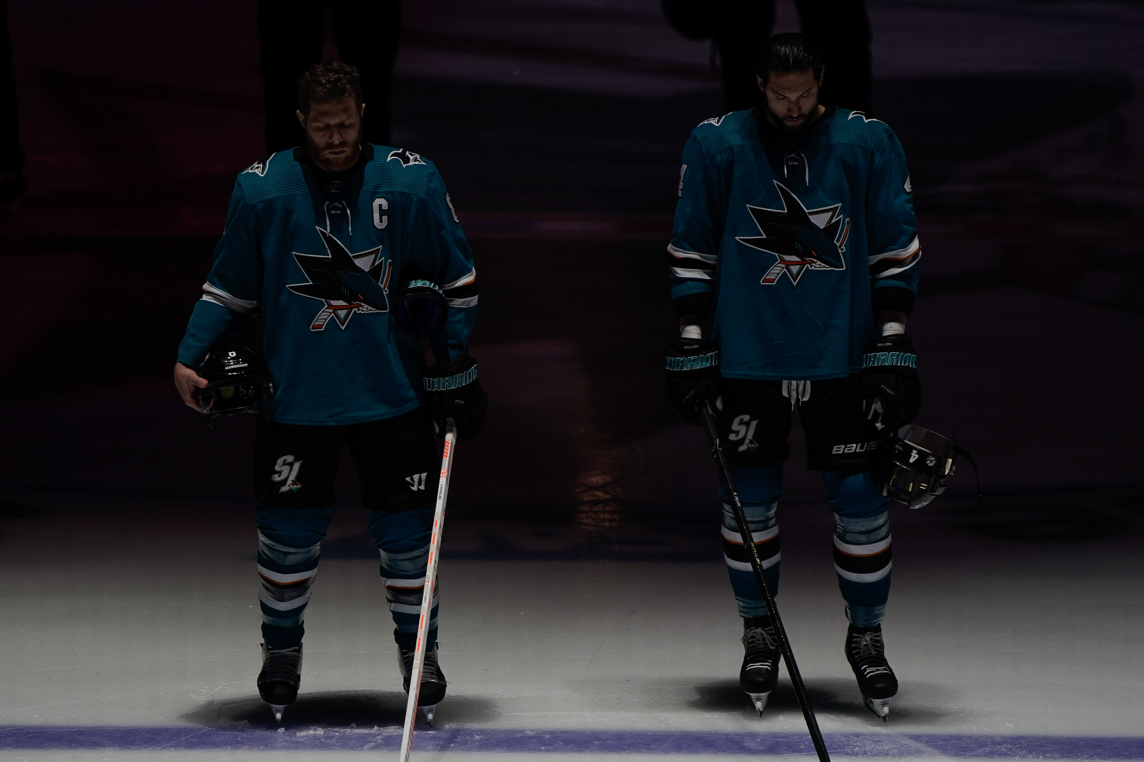 San Jose Sharks center Joe Pavelski (8) and defenseman Erik Karlsson (65) line up for the National Anthem before the game against the St. Louis Blues in Game 5 of the Western Conference Final of the 2019 Stanley Cup Playoffs at SAP Center at San Jose.