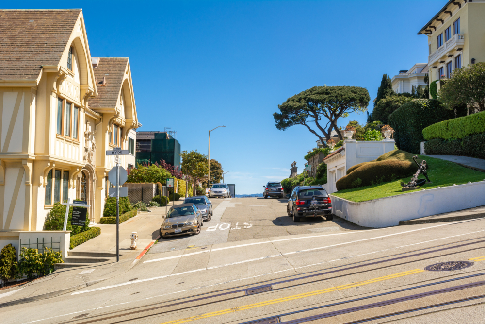 Cable car tracks running by expensive looking San Francisco homes.