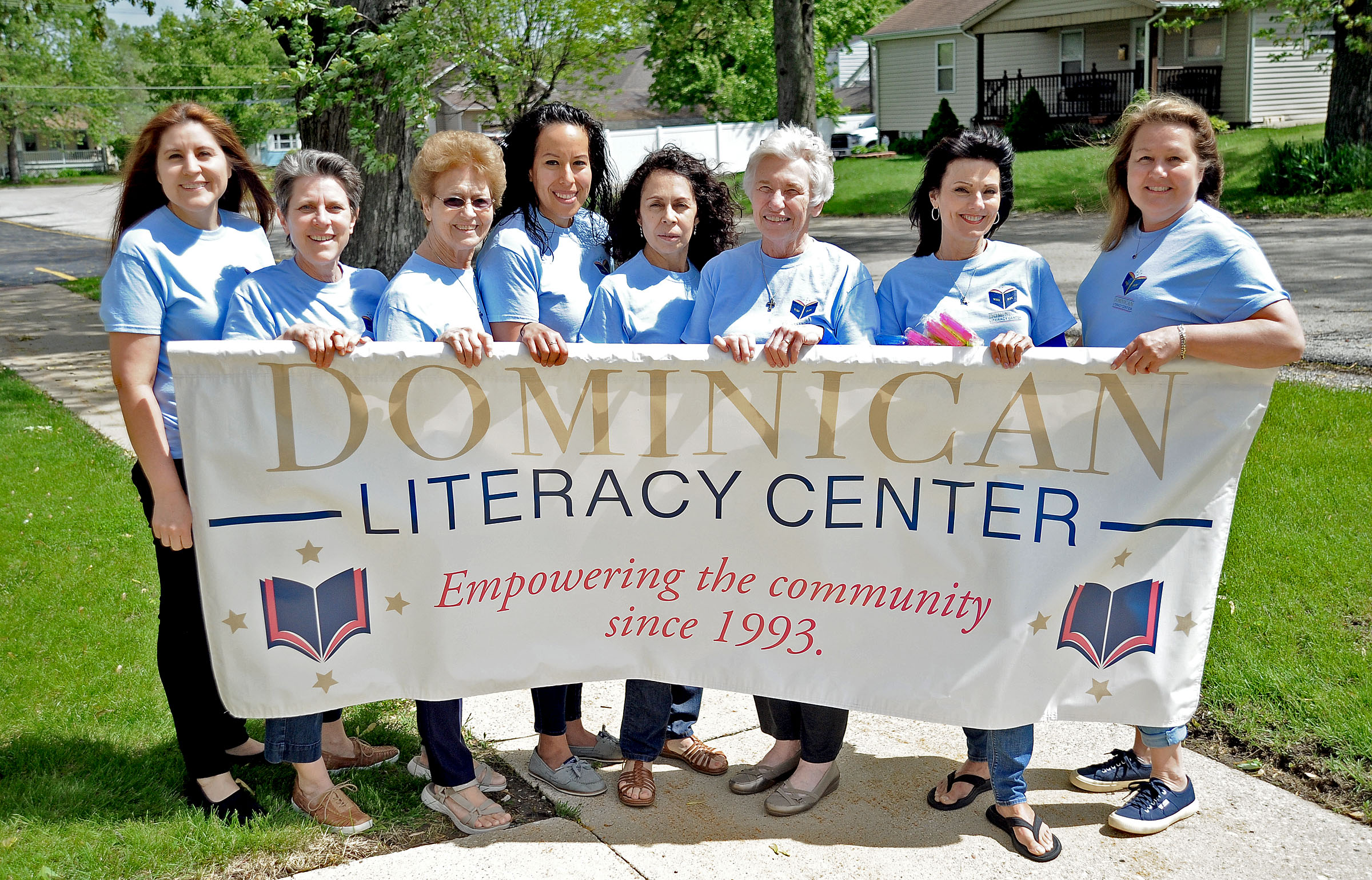 Staff and volunteers from the Dominican Literacy Center in Aurora present their Memorial Day Parade banner, on Wednesday, May 22, 2019. Left to right: Elisa Barocio, Alison Brzezinski, Sister Jane Beckman, Dalila Alegria, Maria Dominguez, Sister Kathleen