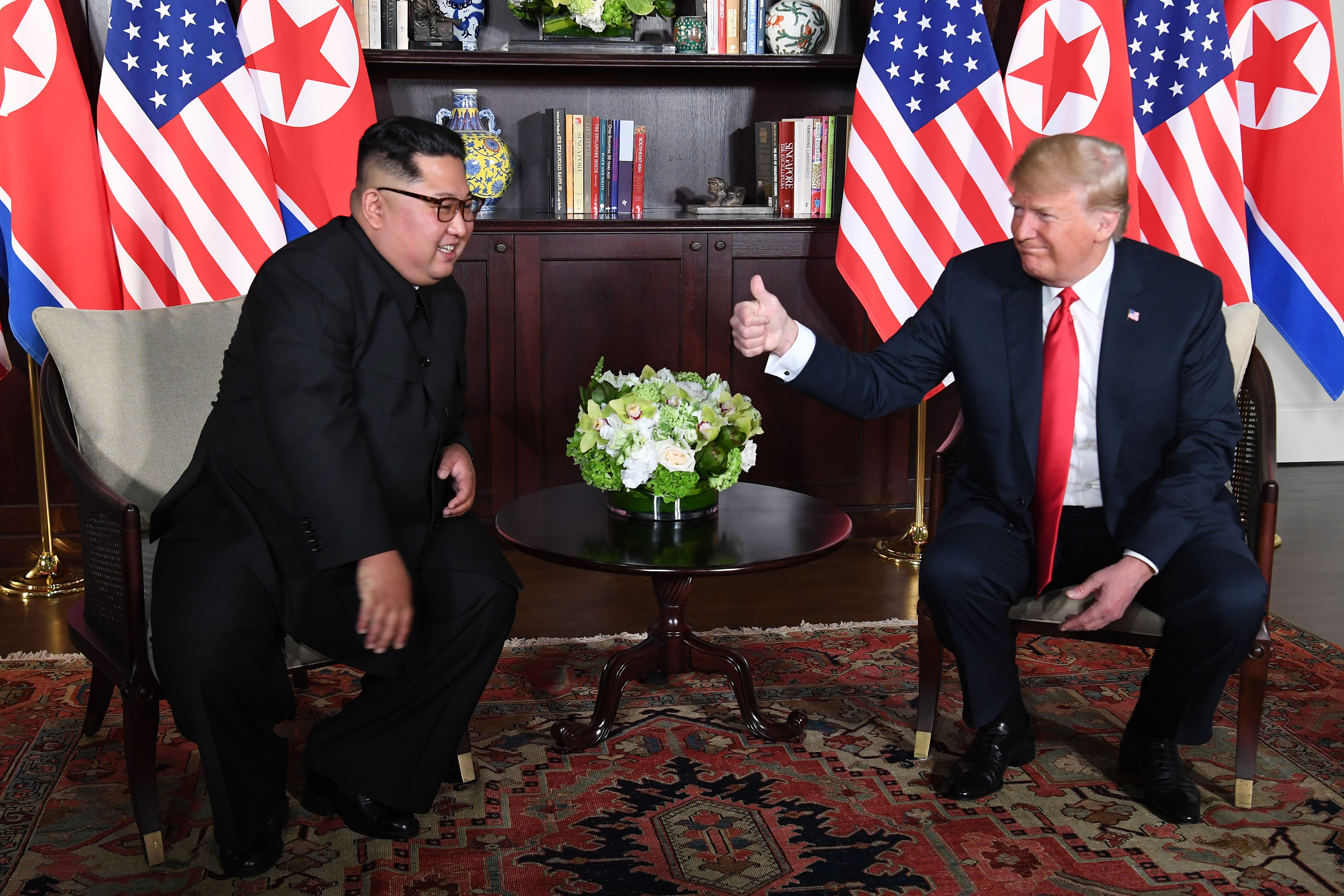 Donald Trump gives Kim Jong Un a thumbs up.