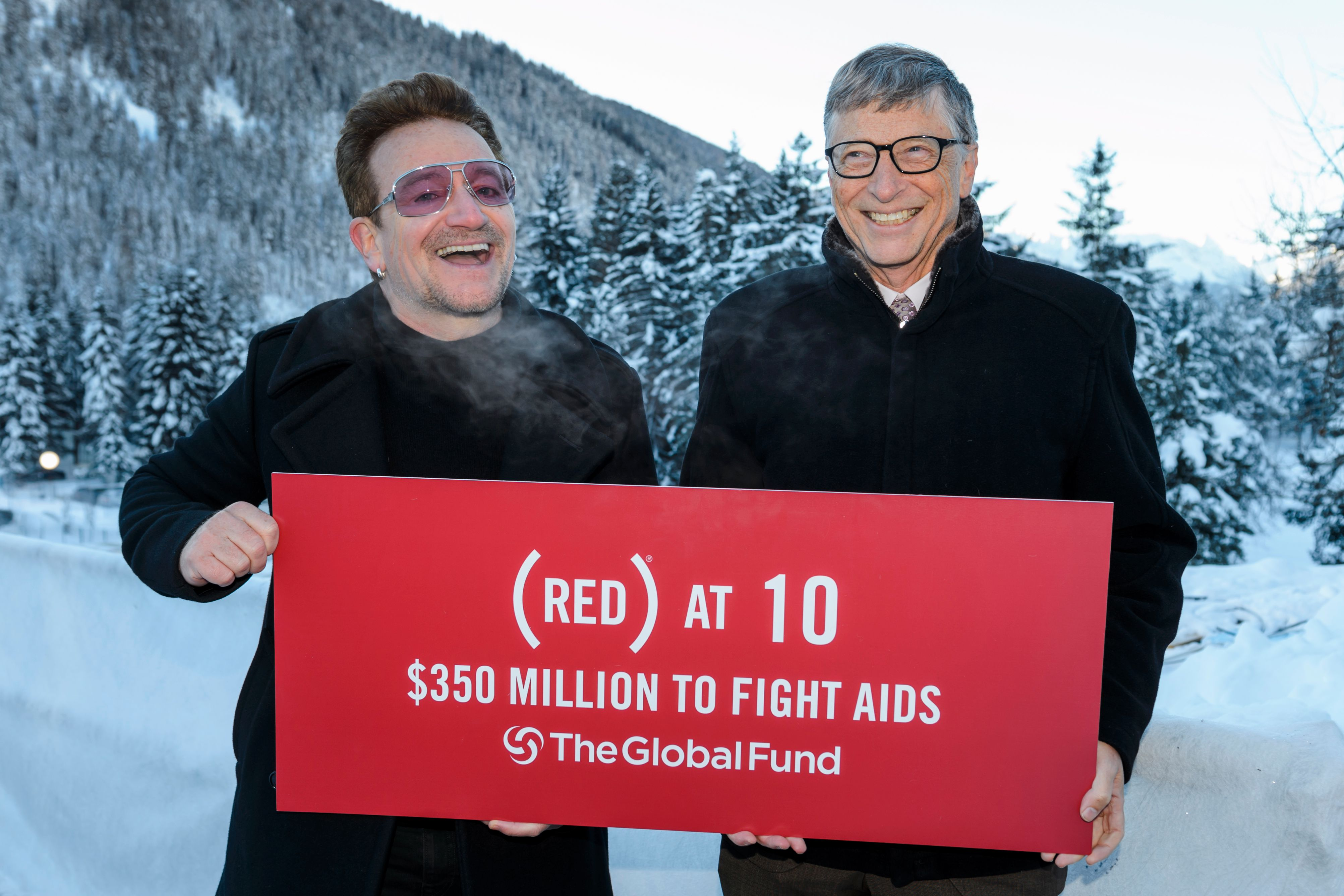 Bono poses with Bill Gates at the World Economic Forum annual meeting on January 22, 2016 in Davos