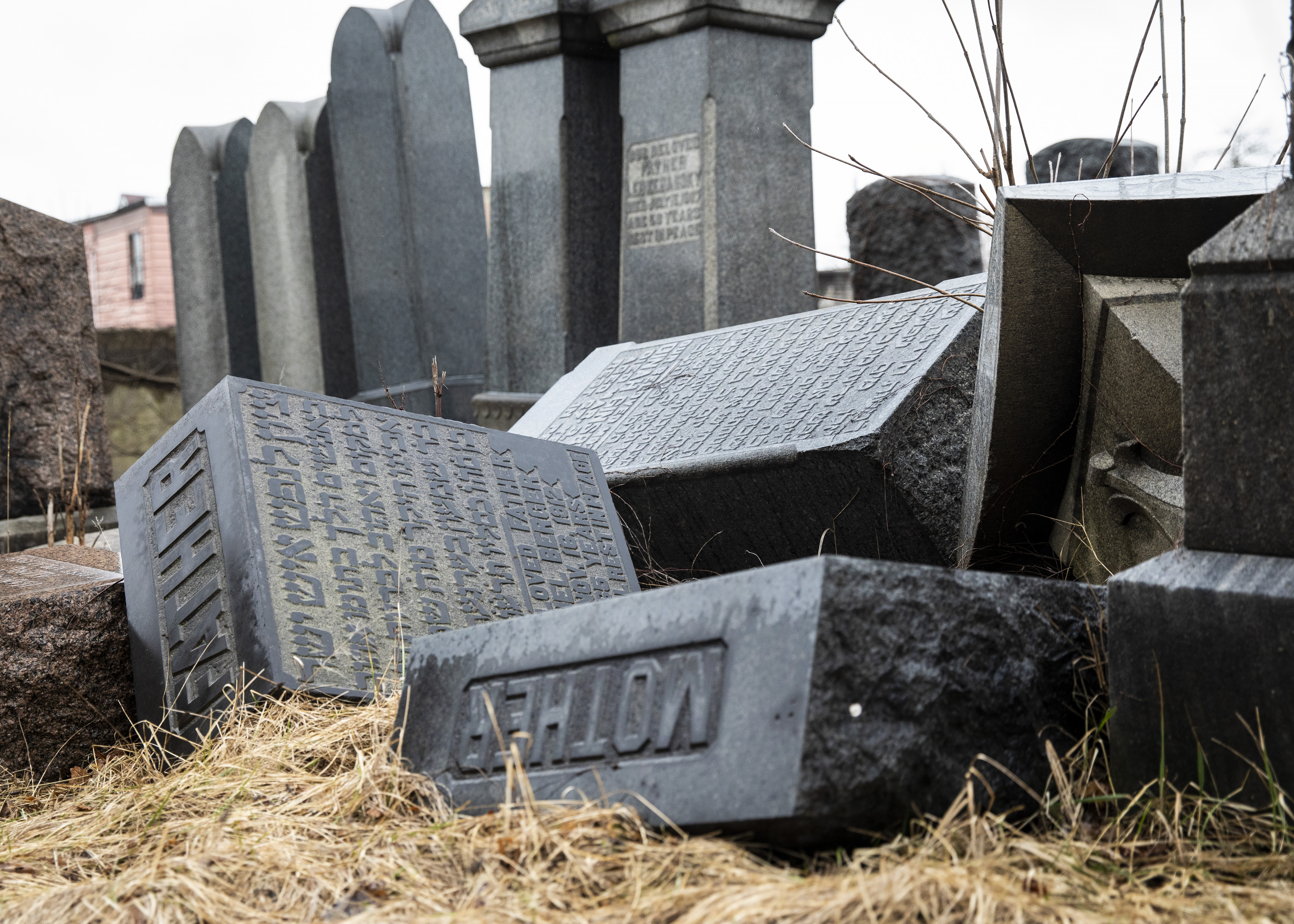 Damaged headstones sit in the Jewish cemetery within the boundaries of Oak Woods Cemetery on Chicago's South Side.
