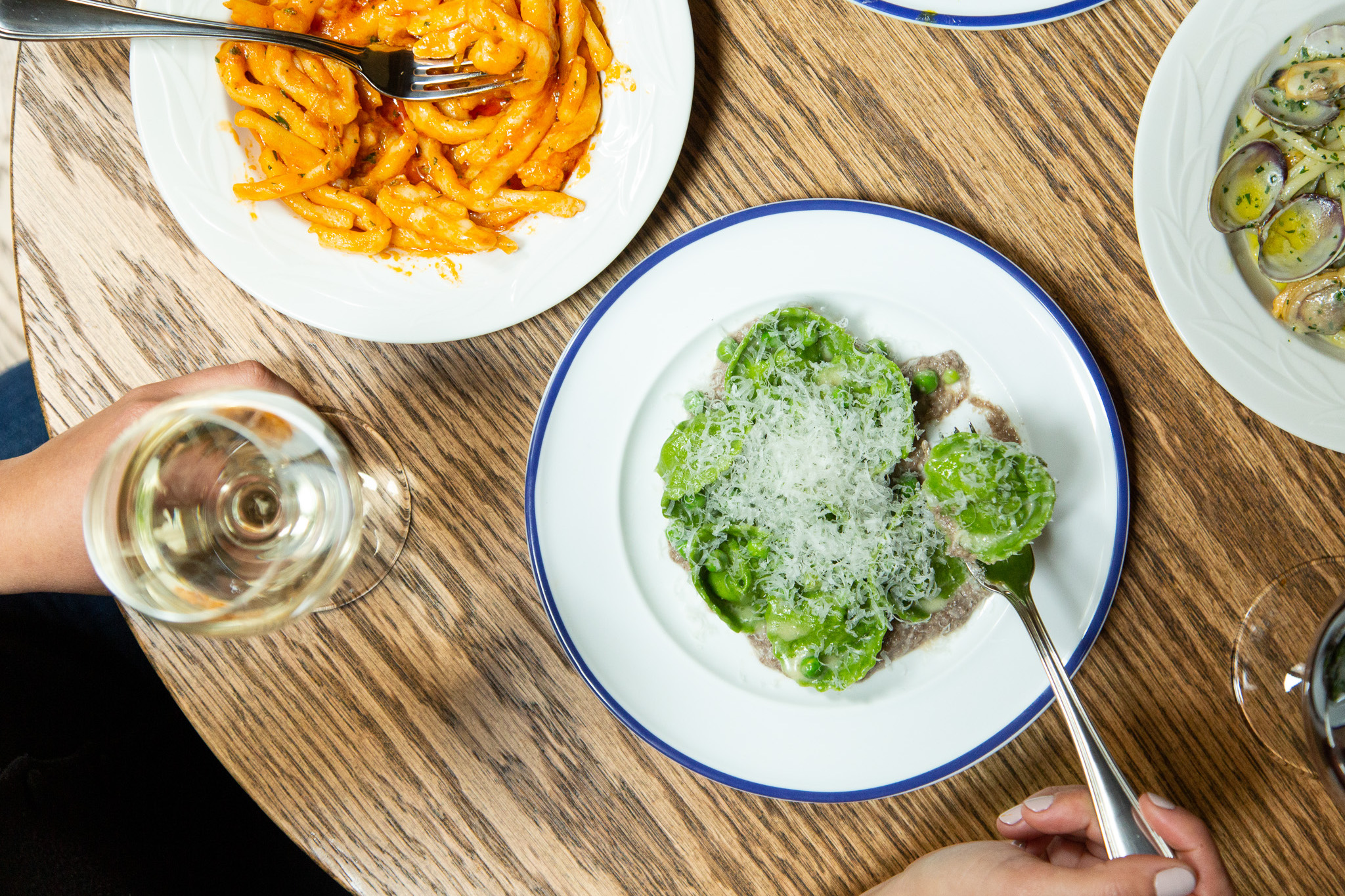A set of plates filled with colorful pastas at Rezdora in New York City