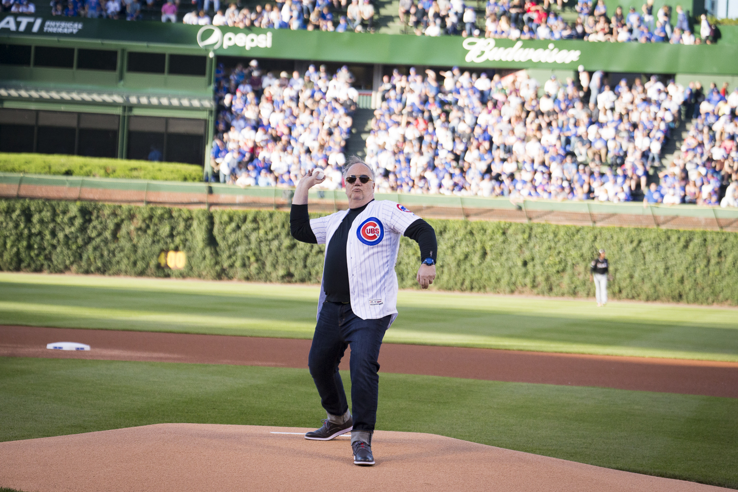 Tony Mantuano throws the first pitch at Wrigley Field.