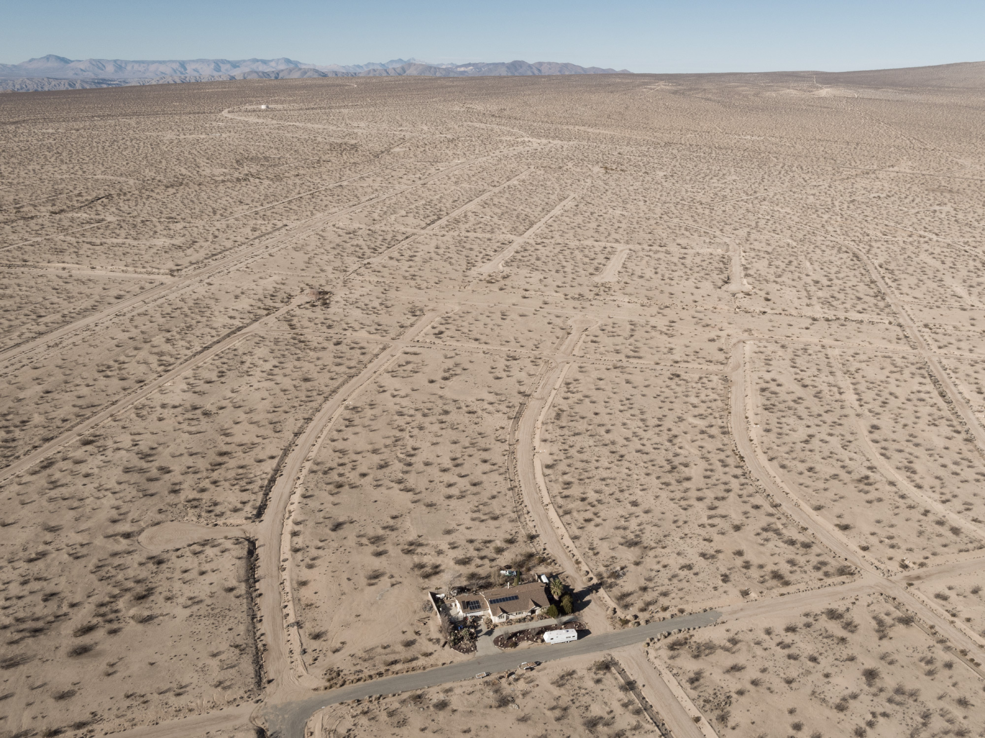 An aerial view of a tiny town in a desert in California.