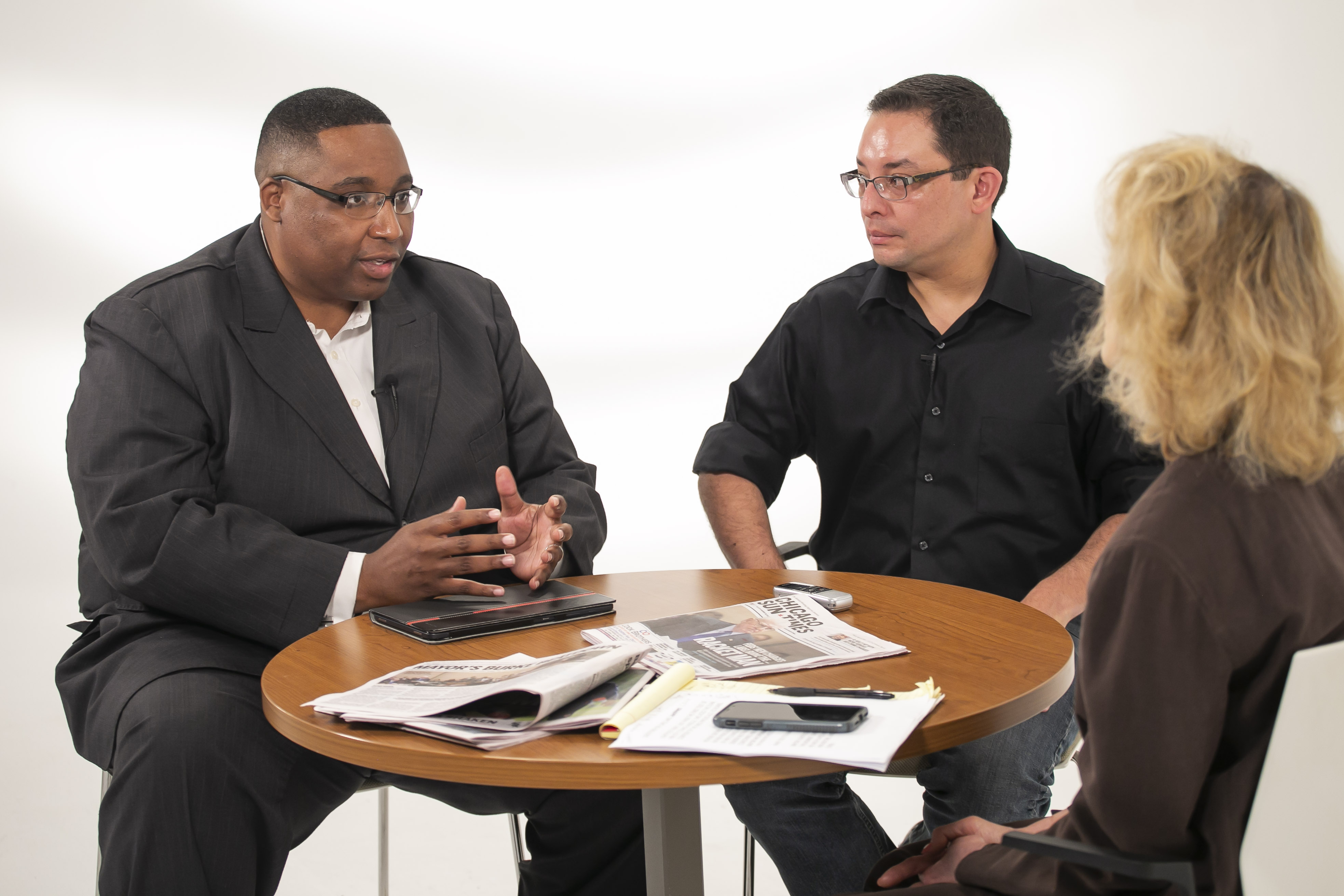 Ald. Jason Ervin (28th), chairman of the City Council's Black Caucus, and Ald. Ray Lopez (15th) talk to Sun-Times City Hall reporter Fran Spielman on May 31, 2019.