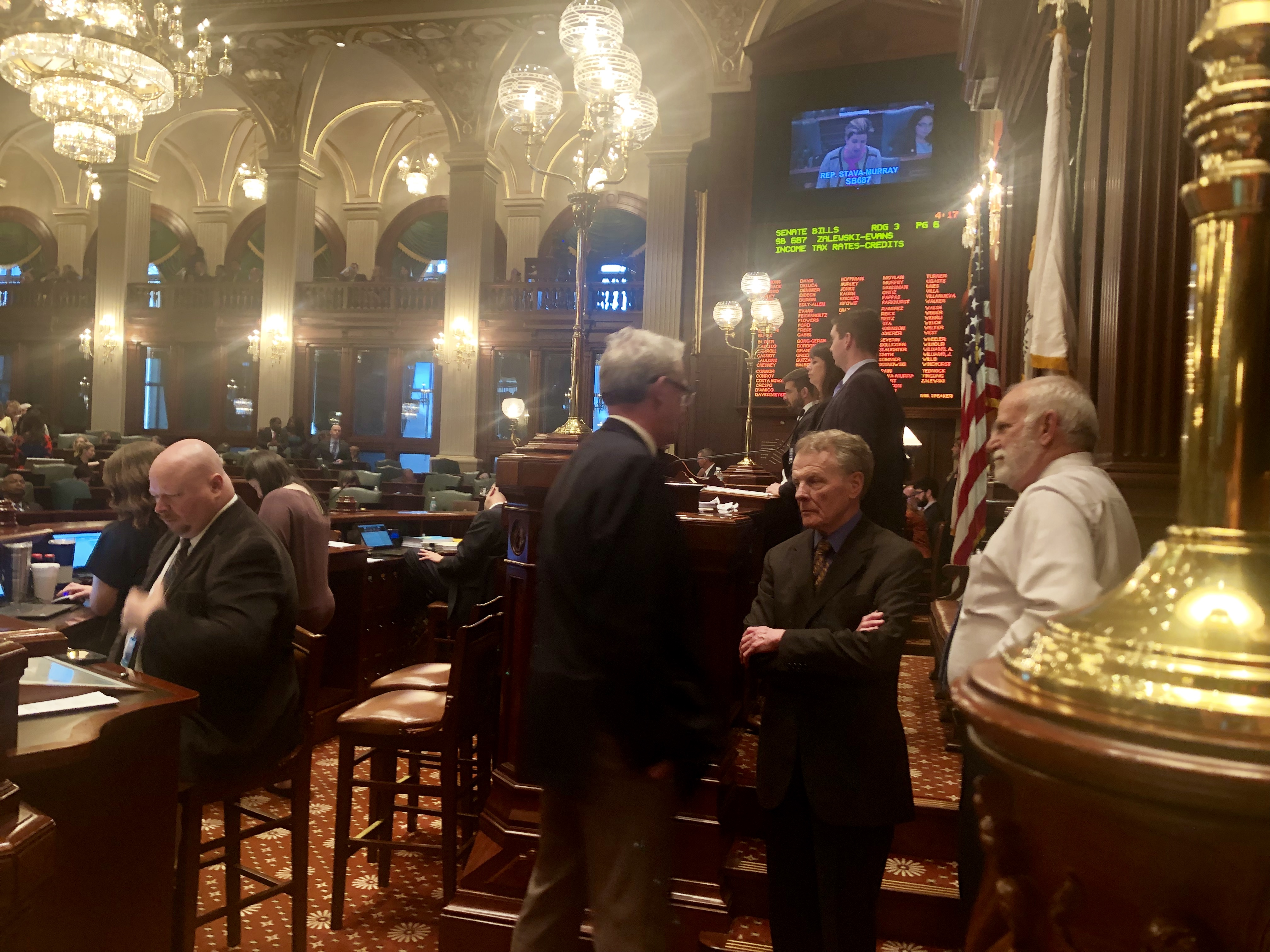 House Republican Leader Jim Durkin and House Speaker Mike Madigan talk on the House floor