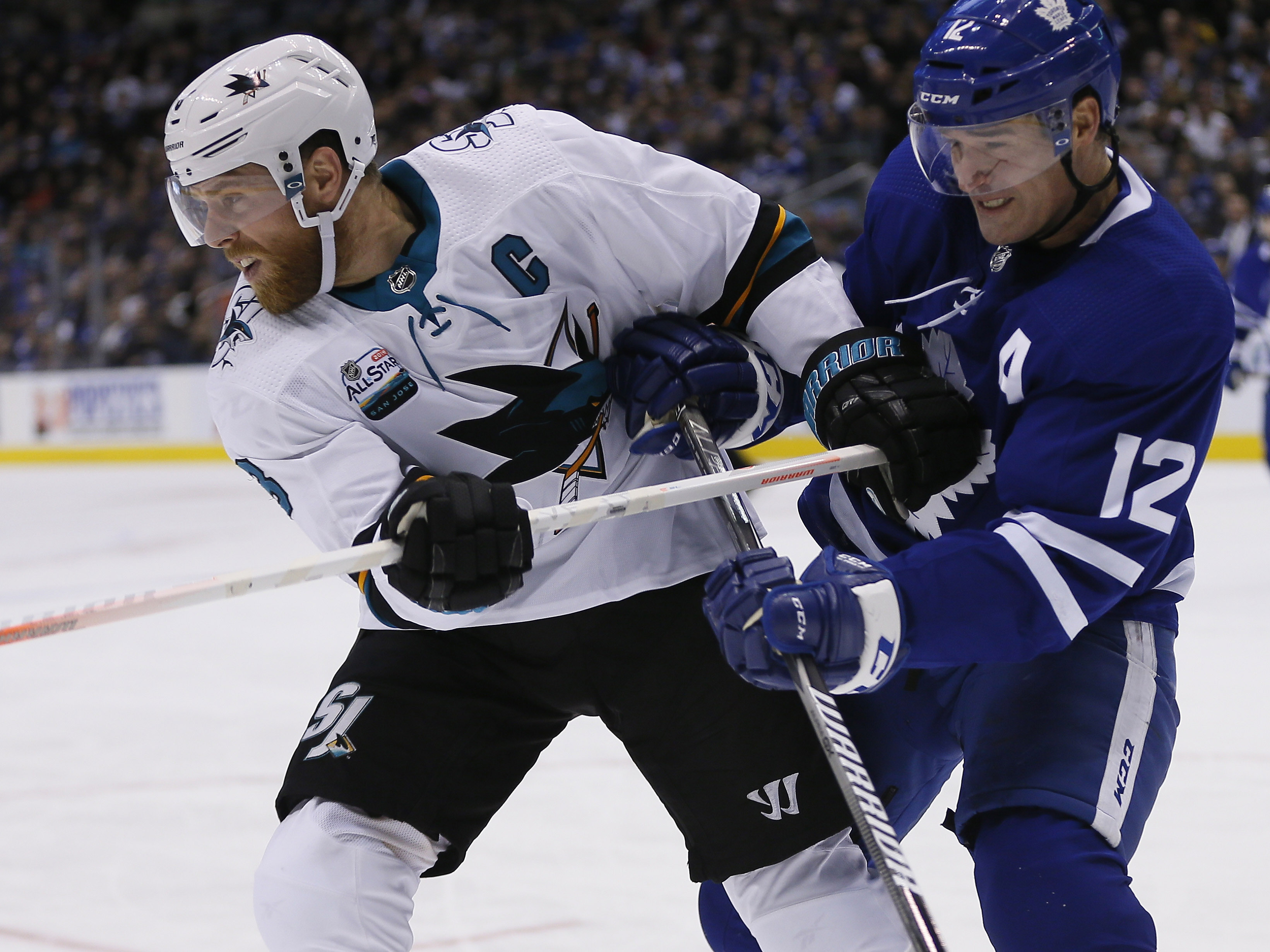Nov 28, 2018; Toronto, Ontario, CAN; San Jose Sharks forward Joe Pavelski and Toronto Maple Leafs forward Patrick Marleau battle for position during the second period at Scotiabank Arena.