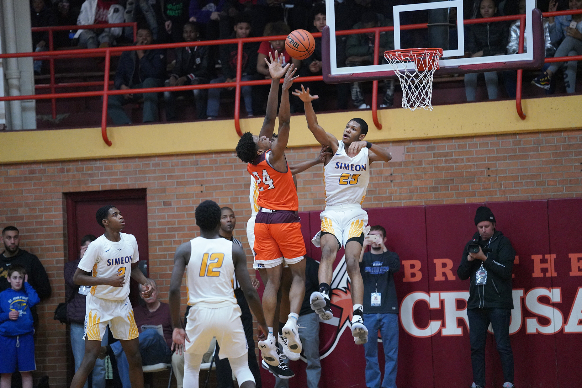 Brother Rice's Marquise Kennedy (24) tries to put a shoot up over Simeon's AJ Casey Jr. (23),