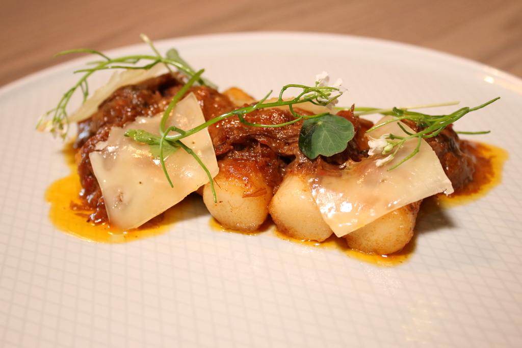 The ddukbokki lamb ragu served at Passerotto restaurant is made withKorean rice cakes and a lamb neck ragu gravy.