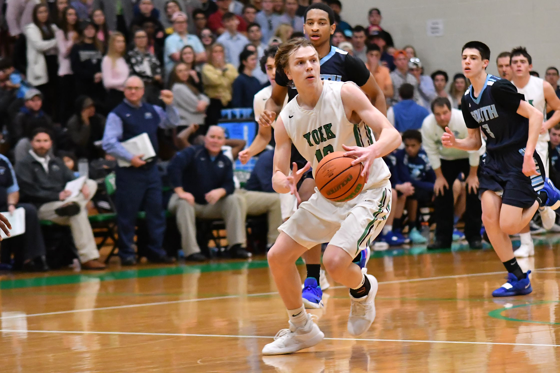 York's Nate Shockey (10) drives down the lane against Downers Grove South.