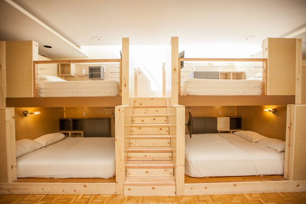 Four enclosed bunk beds in a single room.