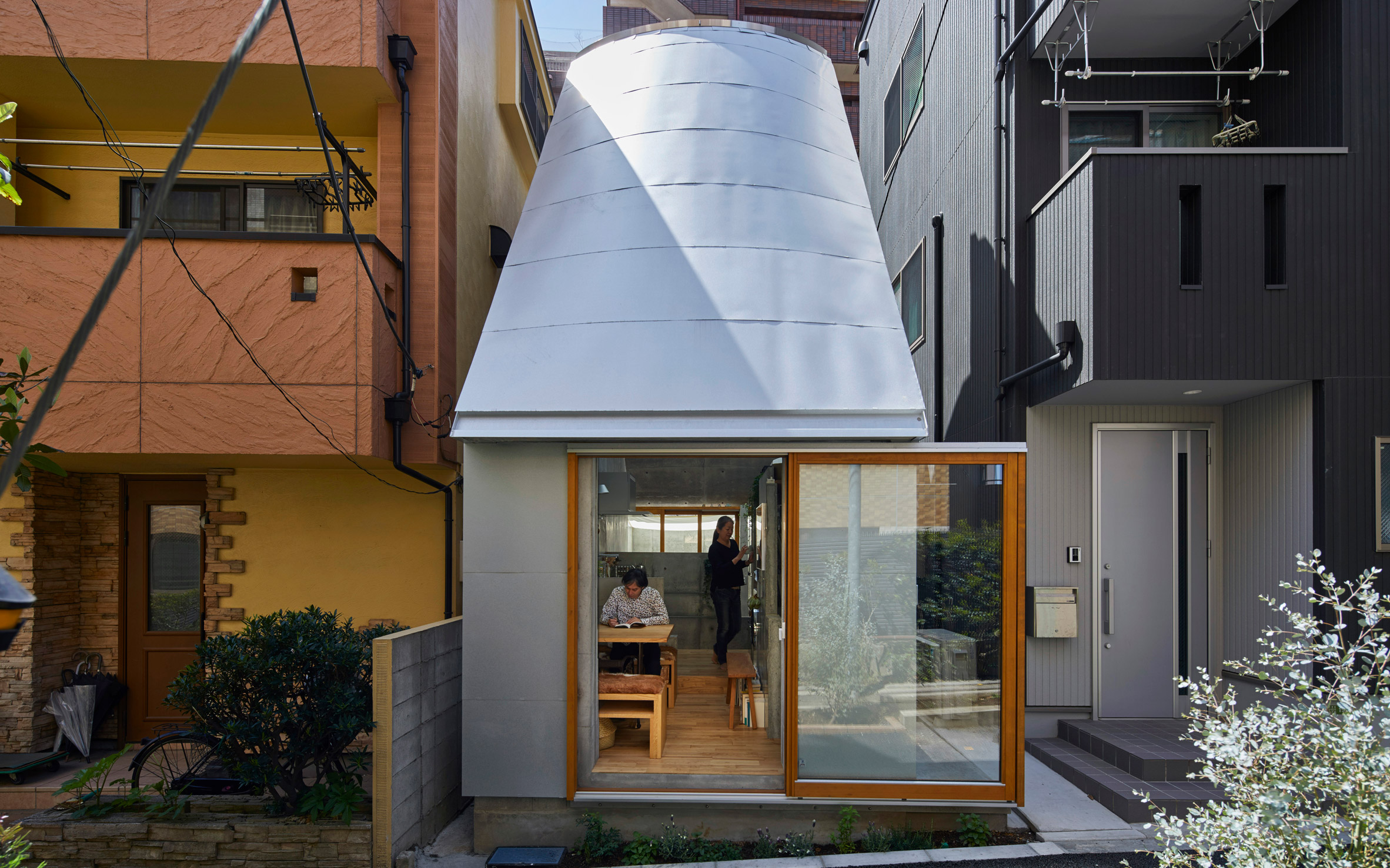 Front of compact house with open window