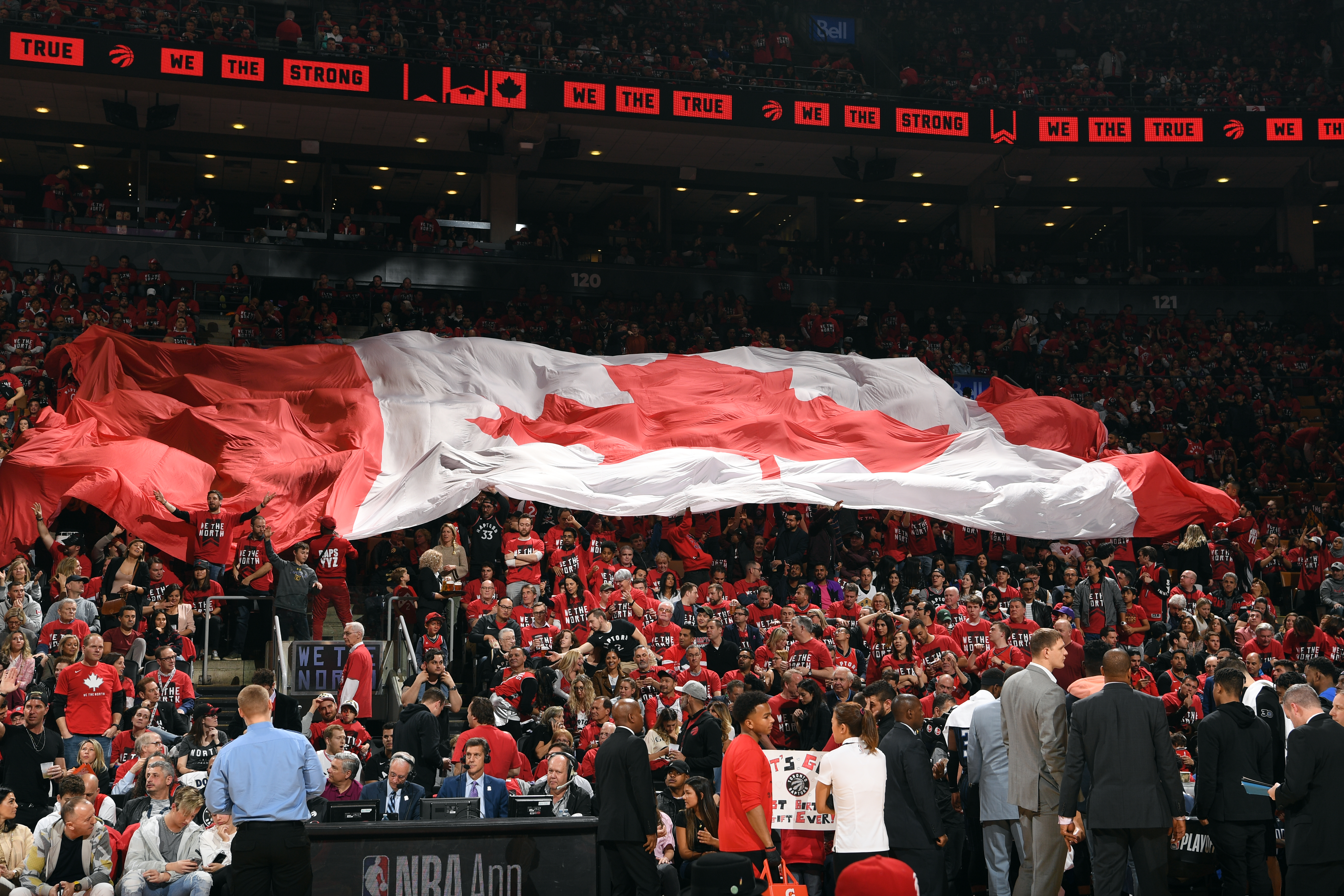 A view of fans holding the Canadian flag during Game One of Round One of the 2019 NBA Playoffs on April 13, 2019 at the Scotiabank Arena in Toronto, Ontario, Canada.