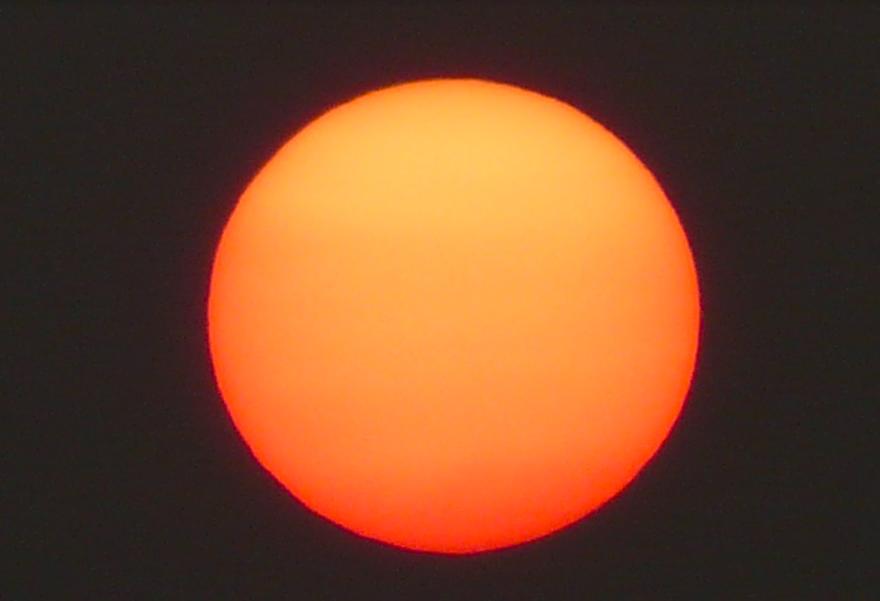 An enormous orange sun.
