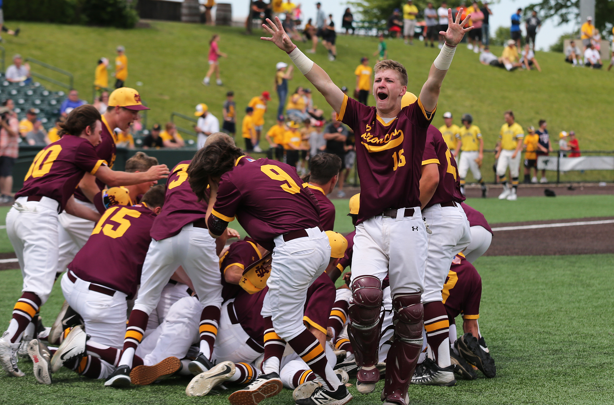 Montini's Nicholas Wind (16) and rest of the Broncos celebrate their 3A state championship at DuPage Medical Group Field in Joliet.