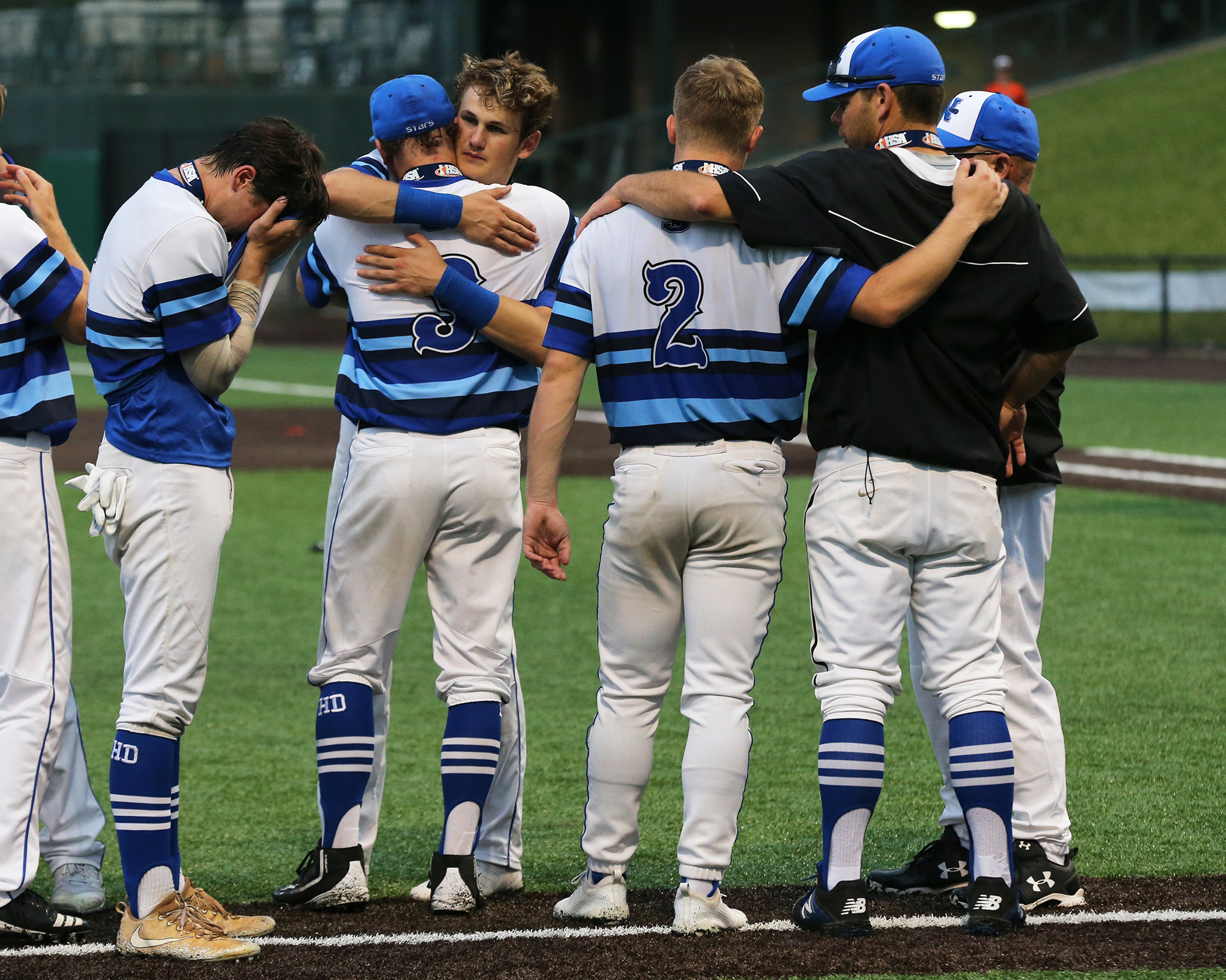 St. Charles North's players console each other after losing the 4A state championship game to Edwardsville.