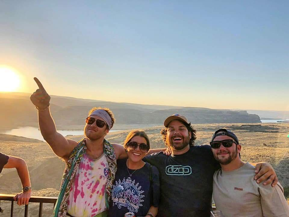 Daniel Bowes (left) with friends at a Phish concert in Washington state.