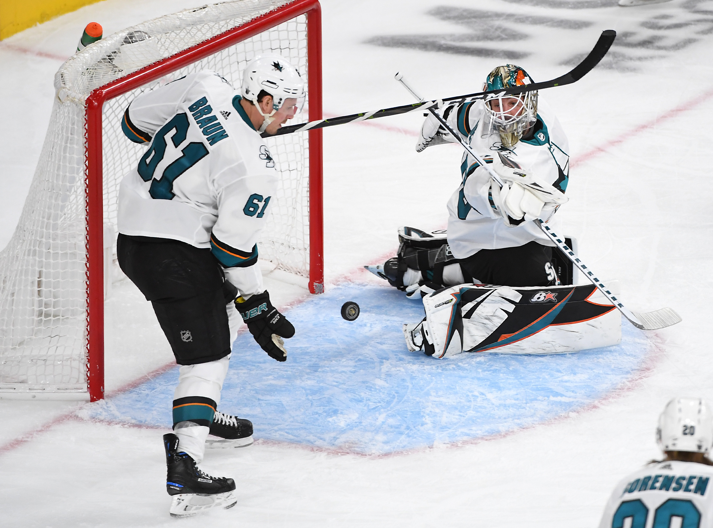 Apr 16, 2019; Las Vegas, NV, USA; San Jose Sharks goaltender Aaron Dell (30) follows the play as San Jose Sharks defenseman Justin Braun (61) gloves the puck near the front of his net during the third period against the Vegas Golden Knights in game four