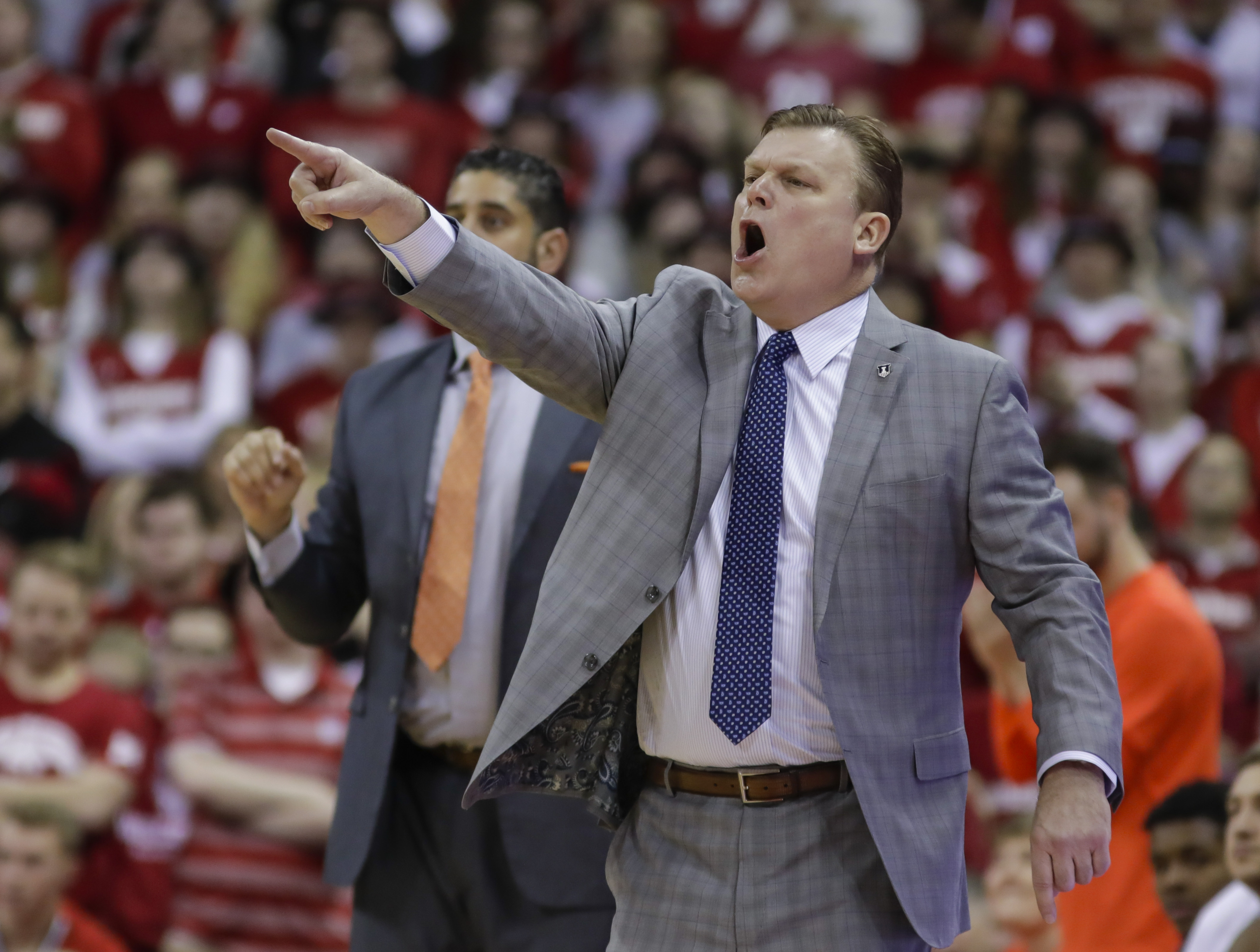 Illinois head coach Brad Underwood yells to his team during the first half against Wisconsin.