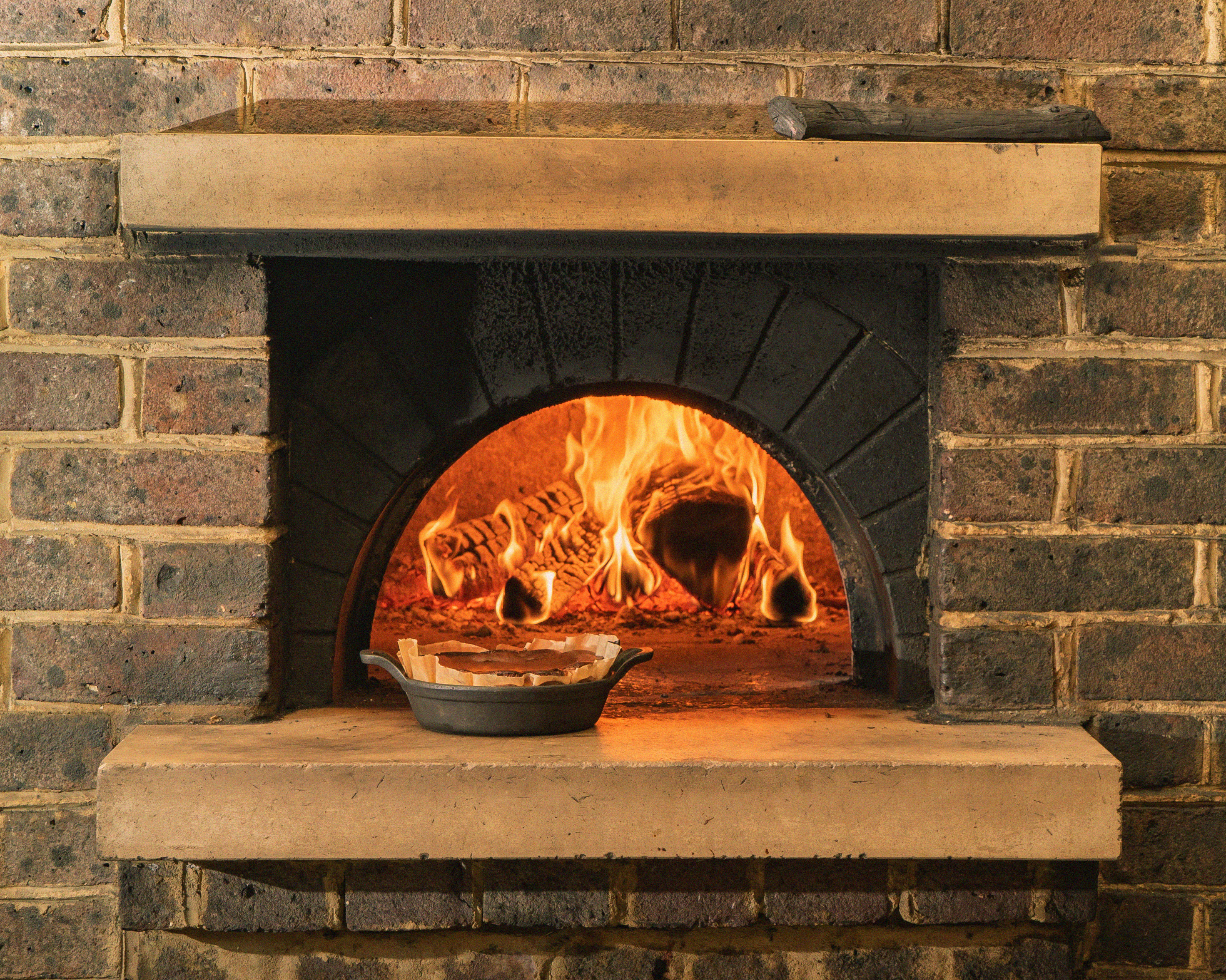 Cheesecake in front of the wood oven at Brat, Eater London's Restaurant of the Year