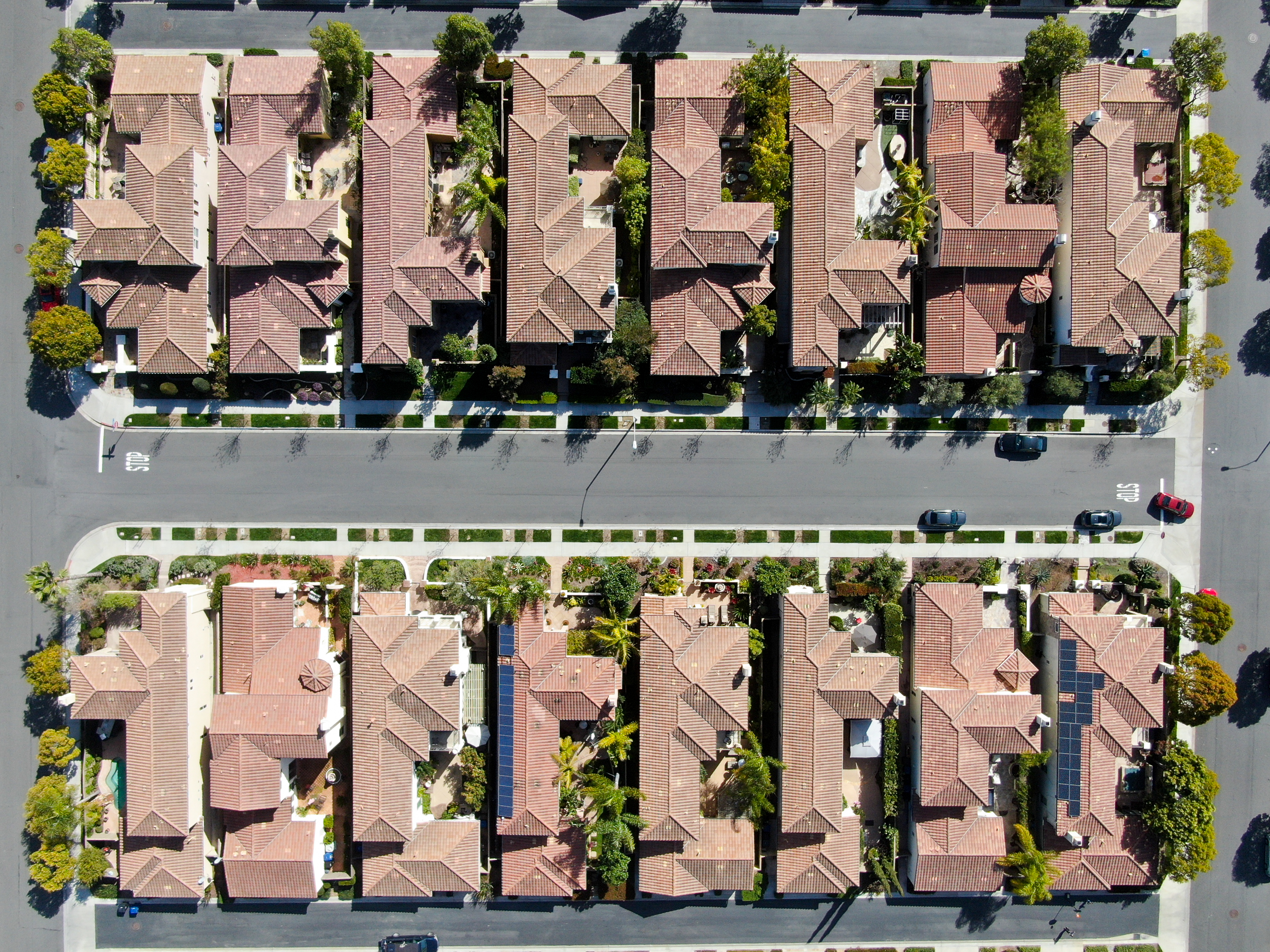 An aerial view of two rows of houses.