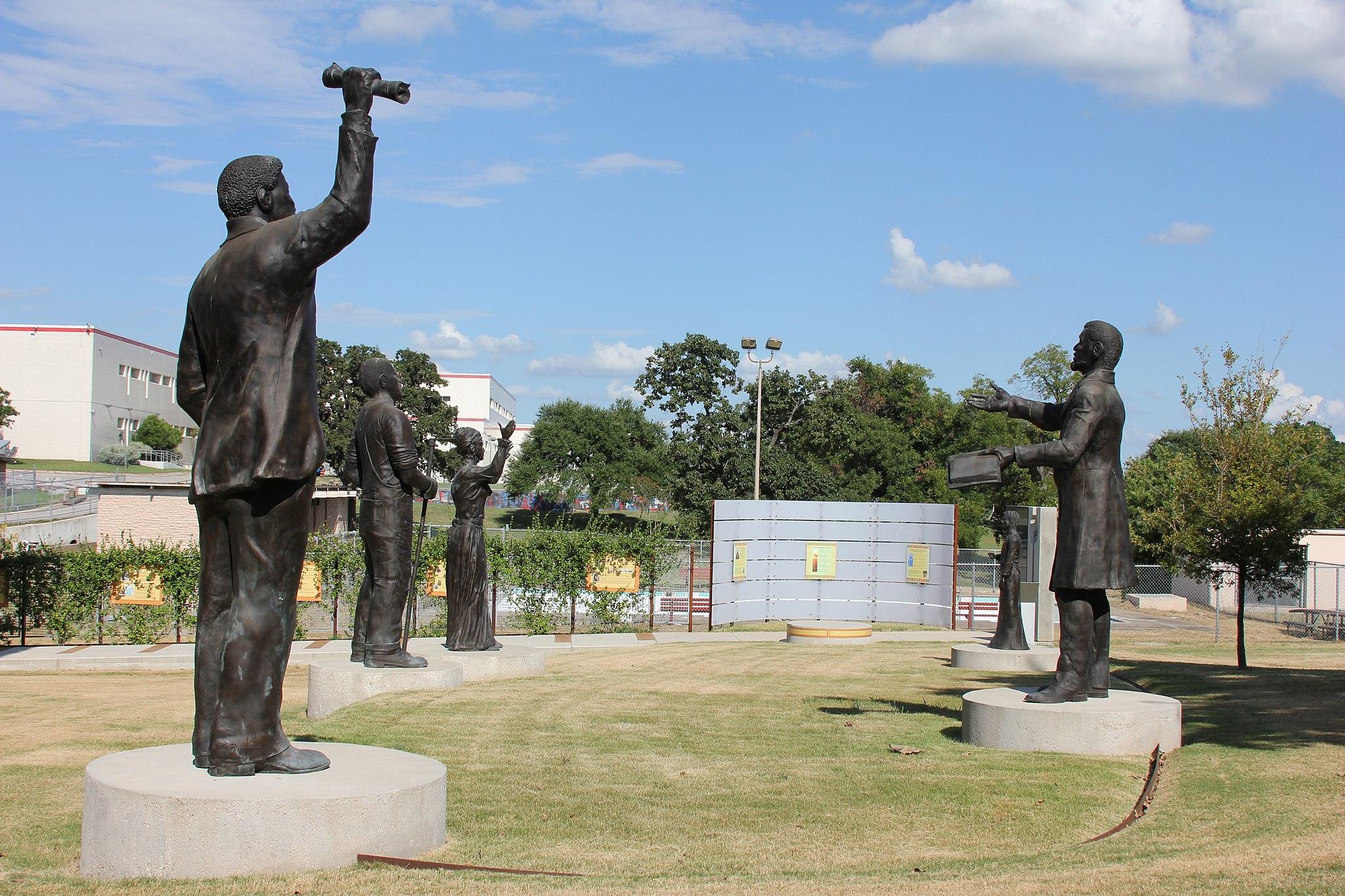 Statues in circular arrangement sharing news