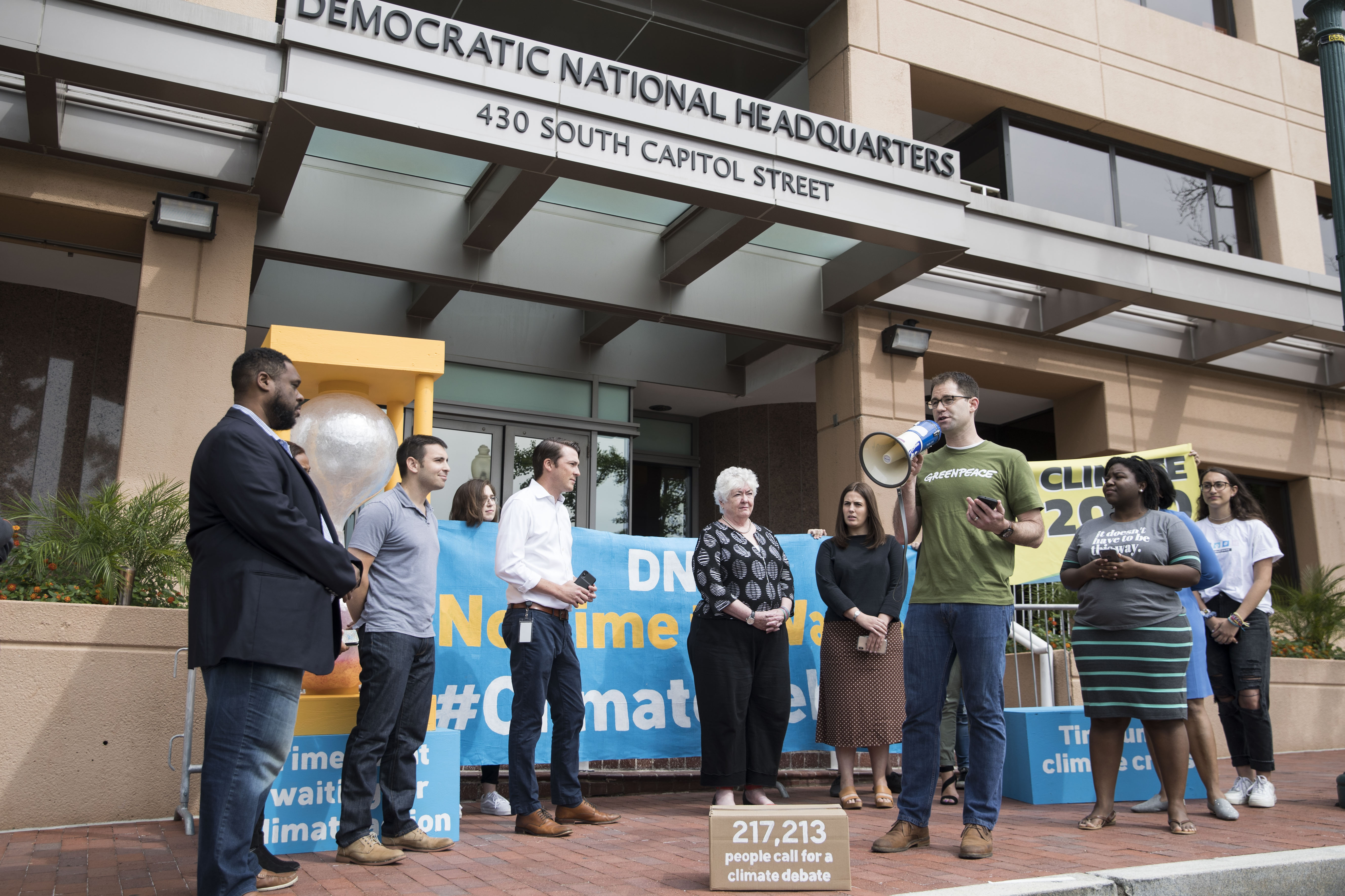 Jack Shapiro speaks in front of the Democratic National Committee headquarters, during a Greenpeace rally to call for a presidential campaign climate debate on June 12, 2019 in Washington, DC.