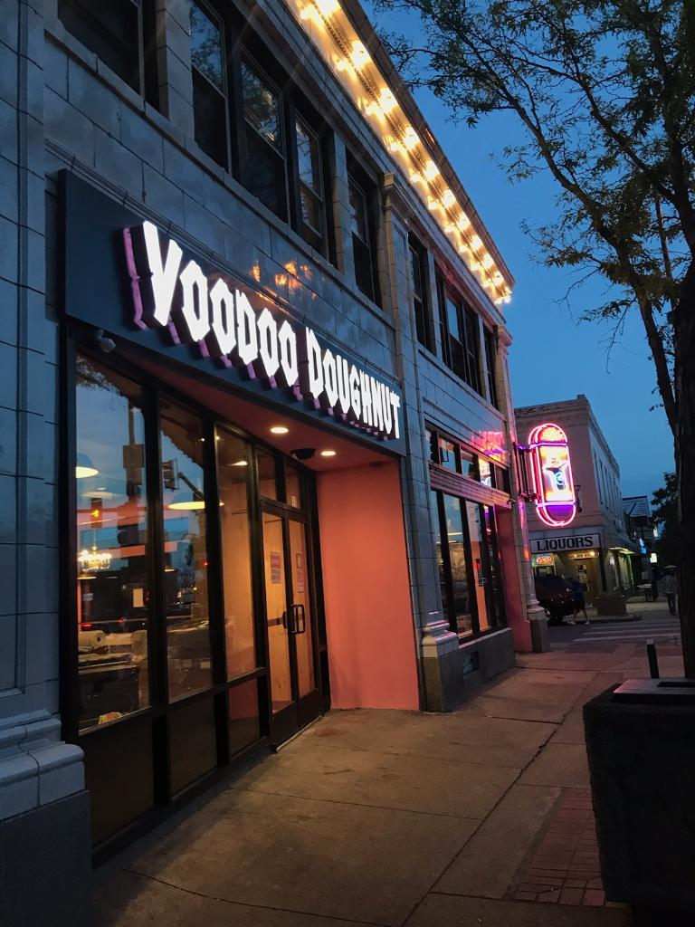 The exterior of the new Voodoo Doughnut on South Broadway including pink Voodoo Doughnut lettering