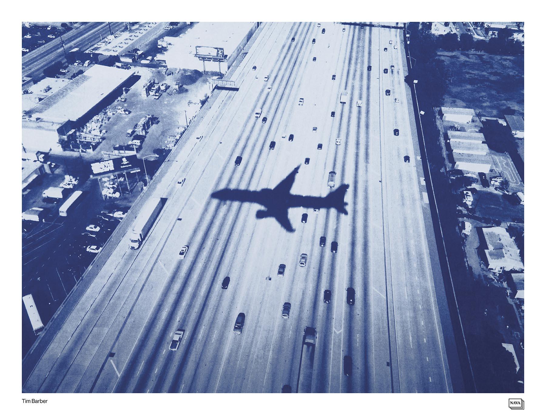 Plane flying over freeway