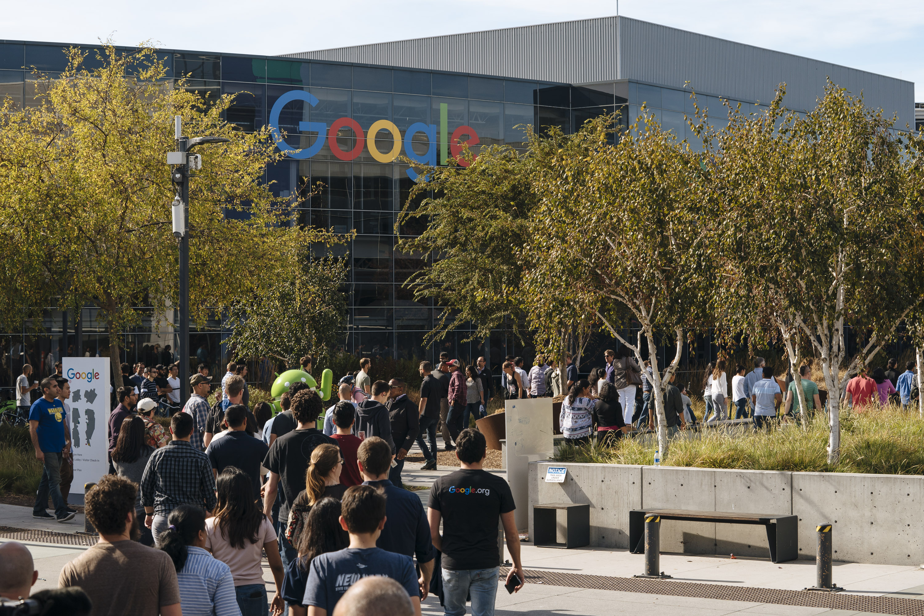 Google employees walking out of Google headquarters.