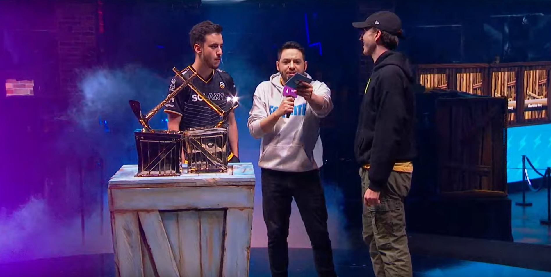 photo of three men standing around Fortnite Pro-Am trophy