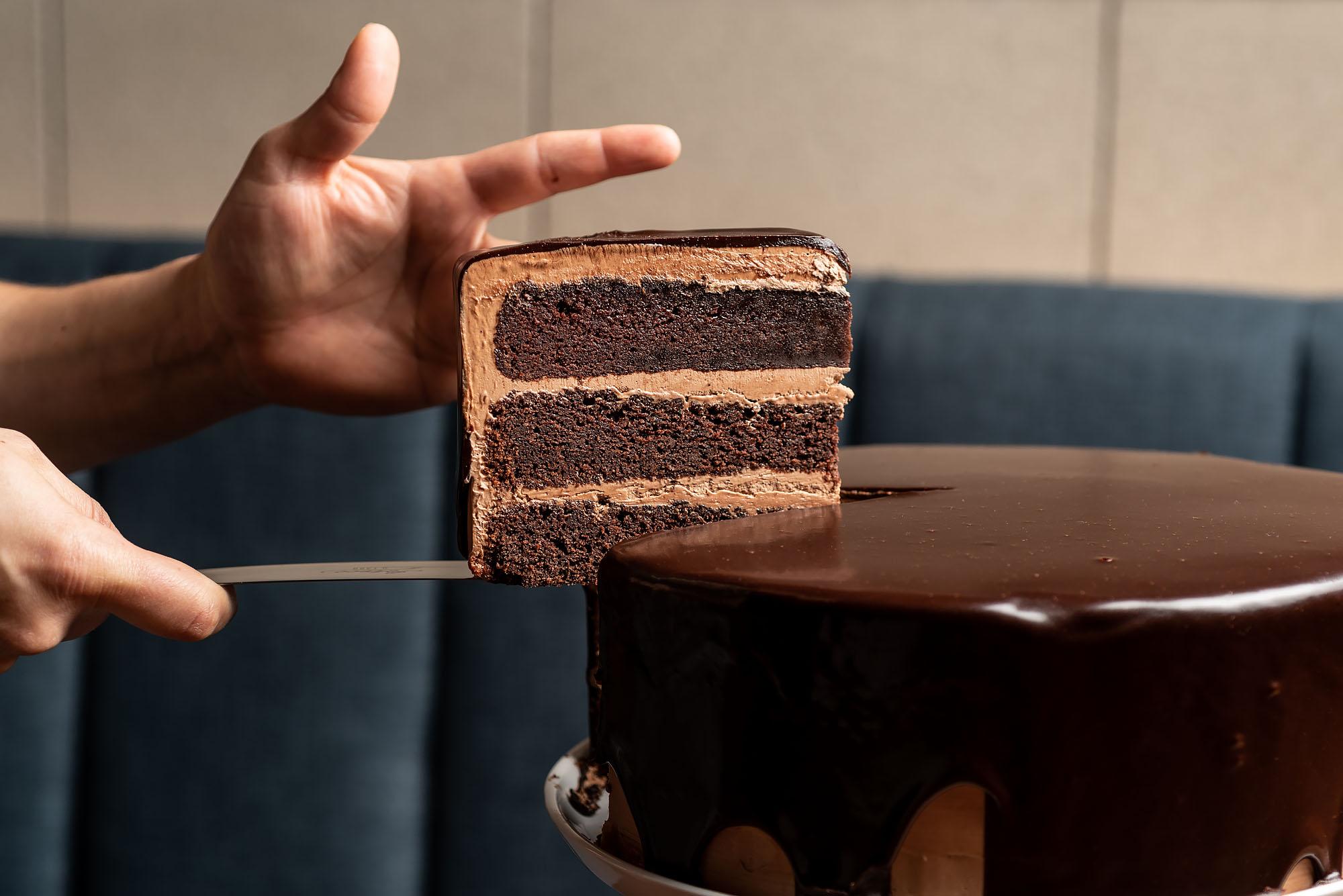A massive slice of chocolate cake.