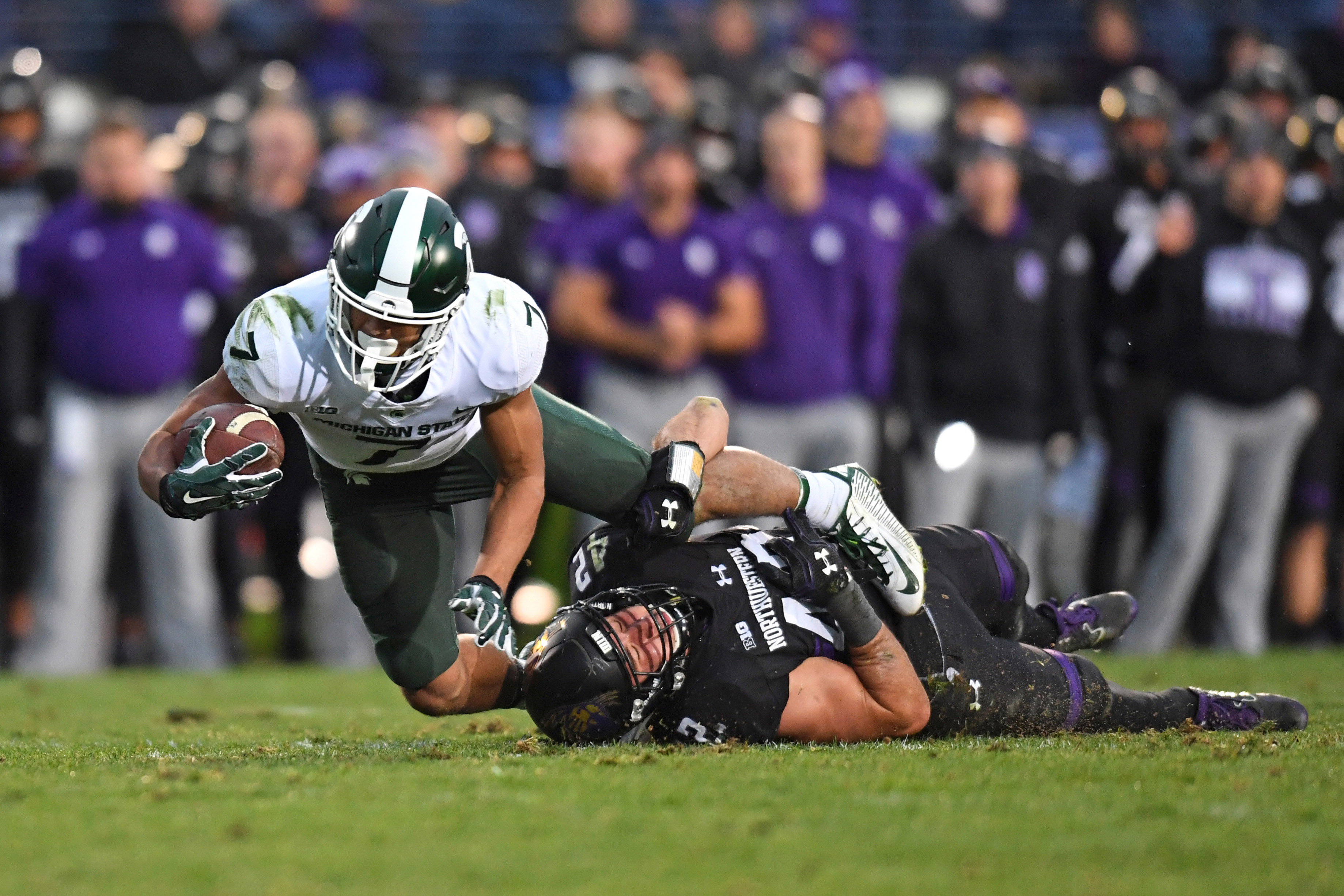 Northwestern Wildcats ILB Paddy Fisher tackles Michigan State Spartans WR Cody White, Oct. 28, 2017.