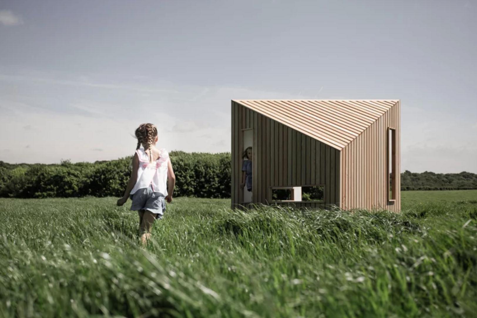Child running to wooden cabin